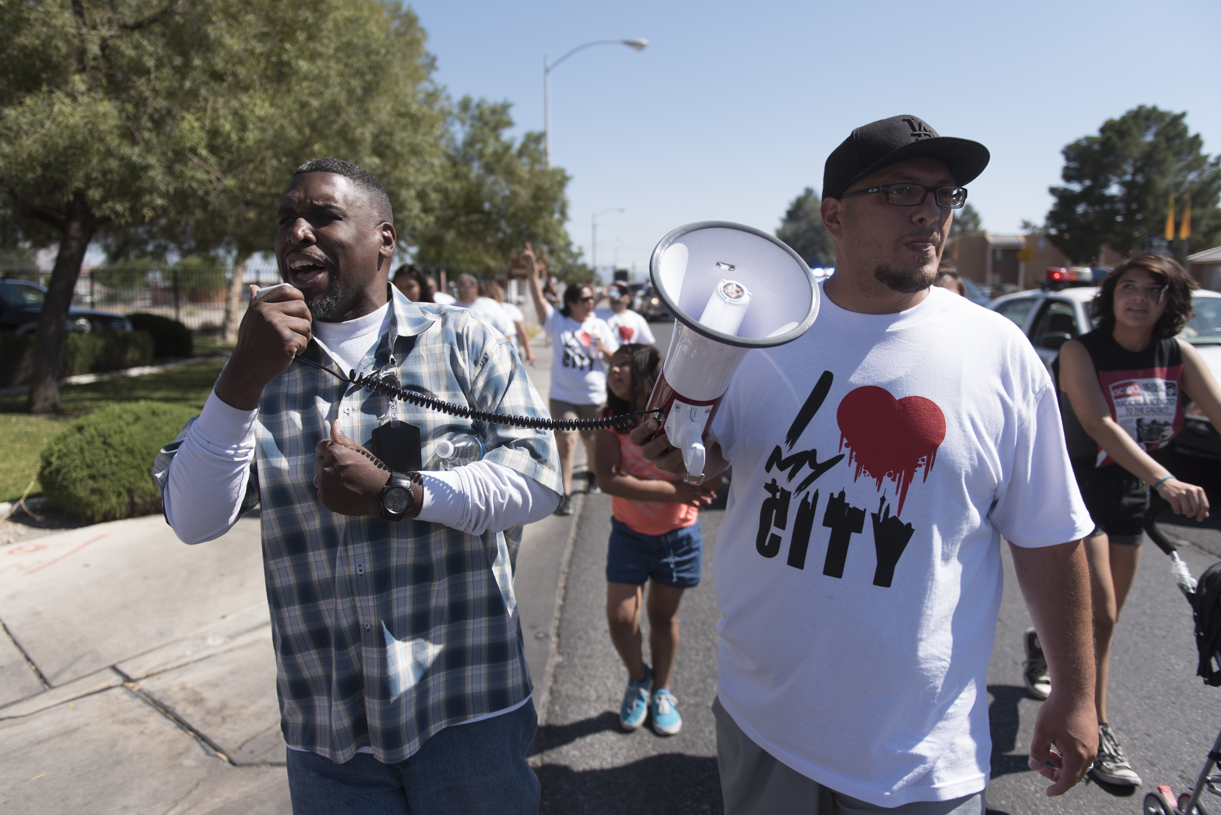 Marchers who have gathered for the I Love My City March walk along Nellis Boulevard, heading towards the closed Walmart at Craig Road in Las Vegas on Saturday, May 21, 2016. (Jason Ogulnik/Las Vegas Review-Journal)