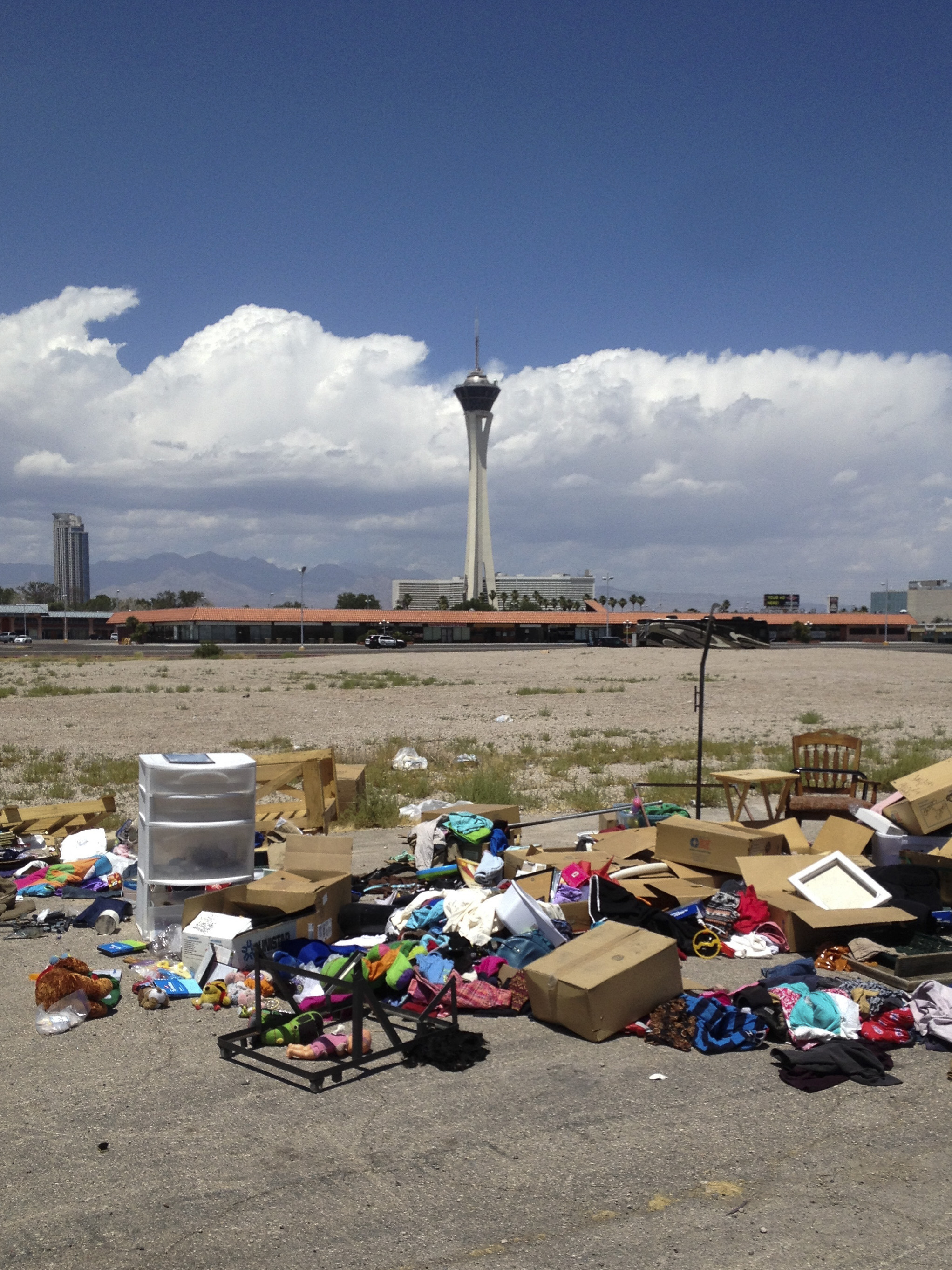 Heaps of random items line a parking lot near Karen Avenue and Maryland Parkway in Las Vegas Sunday, June 12, 2016.
