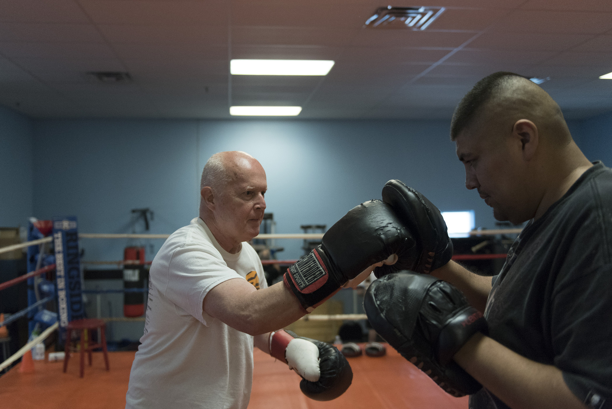 Robert Nicholson, left, does punching exercises with instructor Alvaro Morales during the Rock Steady Boxing Program at Richard Steele Boxing Club in North Las Vegas Monday, June 20, 2016. The therapy helps to slow the effects of Parkinson's disease. Jason Ogulnik/Las Vegas Review-Journal