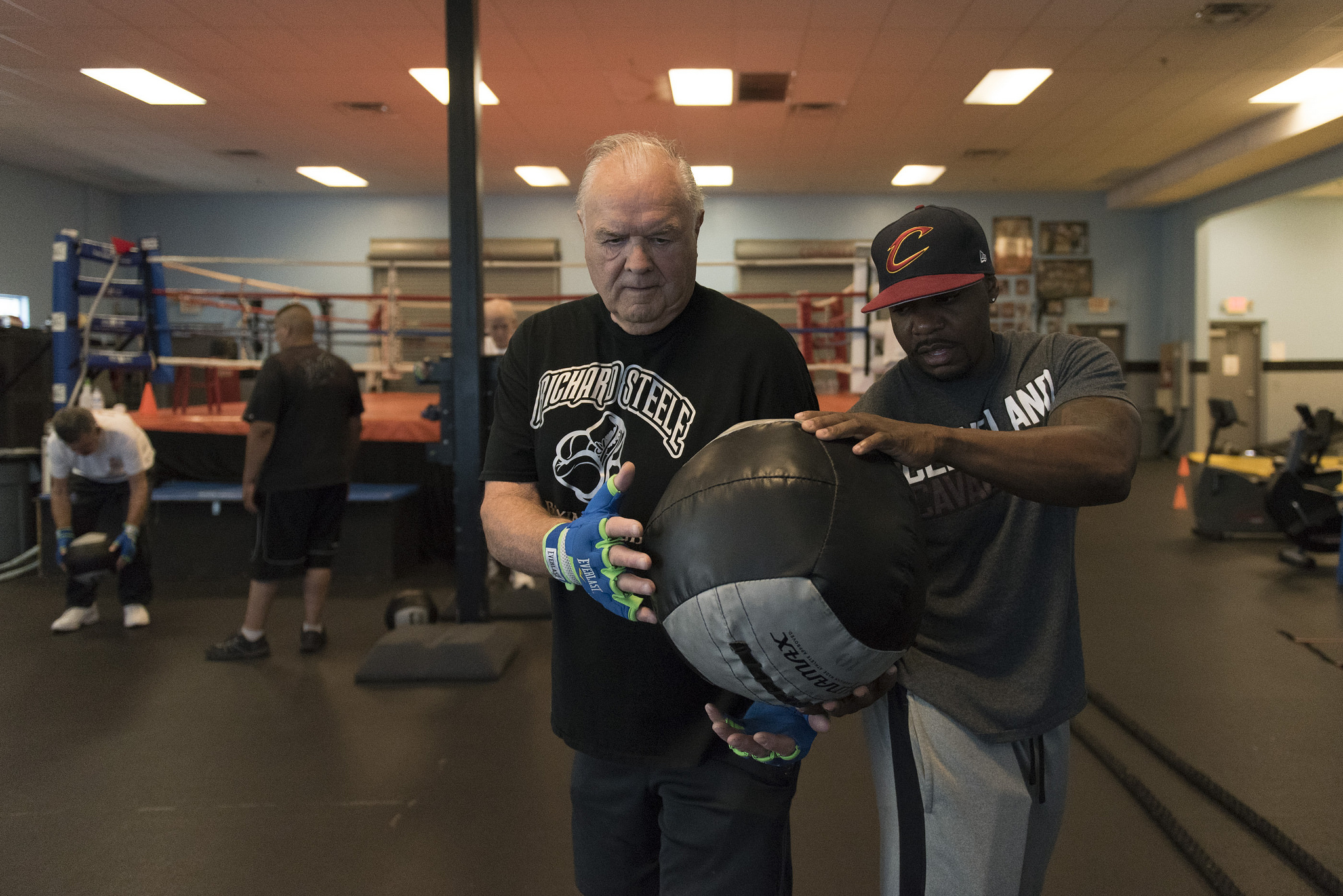 Instructor Donche King, right, and Jerry Sloan do ball exercises during the Rock Steady Boxing Program at Richard Steele Boxing Club in North Las Vegas Monday, June 20, 2016.  The therapy helps to slow the effects of Parkinson's disease. Jason Ogulnik/Las Vegas Review-Journal