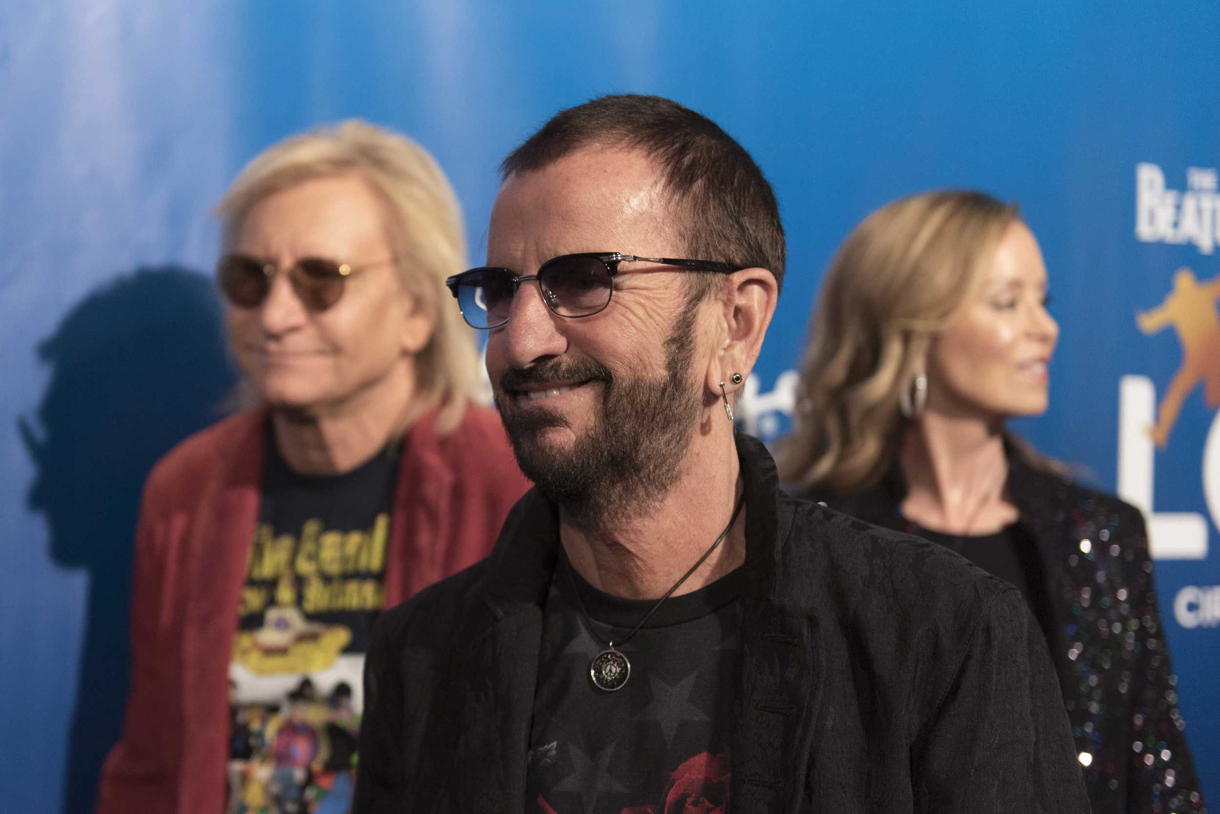 Drummer for the Beatles Ringo Starr, center, poses during a red carpet event to celebrate the 10th anniversary of Cirque du Soleil's The Beatles LOVE at The Mirage hotel-casino in Las Vegas Thursday, July 14, 2016. Joe Walsh of Ringo Starr & His All-Starr Band, left, and Walsh's wife, Marjorie Bach, look on. Jason Ogulnik/Las Vegas Review-Journal