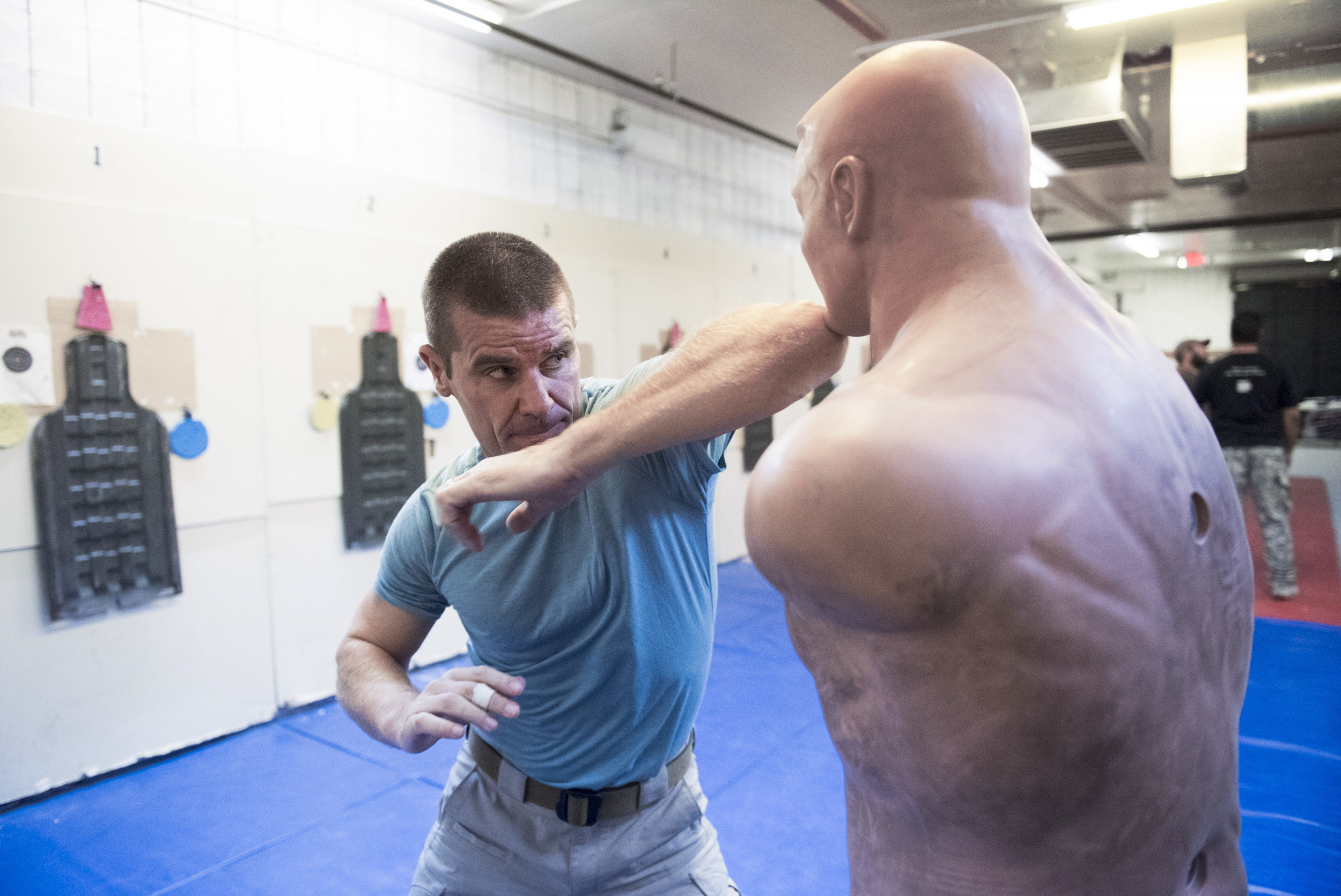 John Ivens demonstrates hand to hand combat techniques during the bodyguards adventure course at Vegas Tactical Adventures in North Las Vegas Tuesday, Aug. 18, 2015. (Jason Ogulnik/Las Vegas Review-Journal)