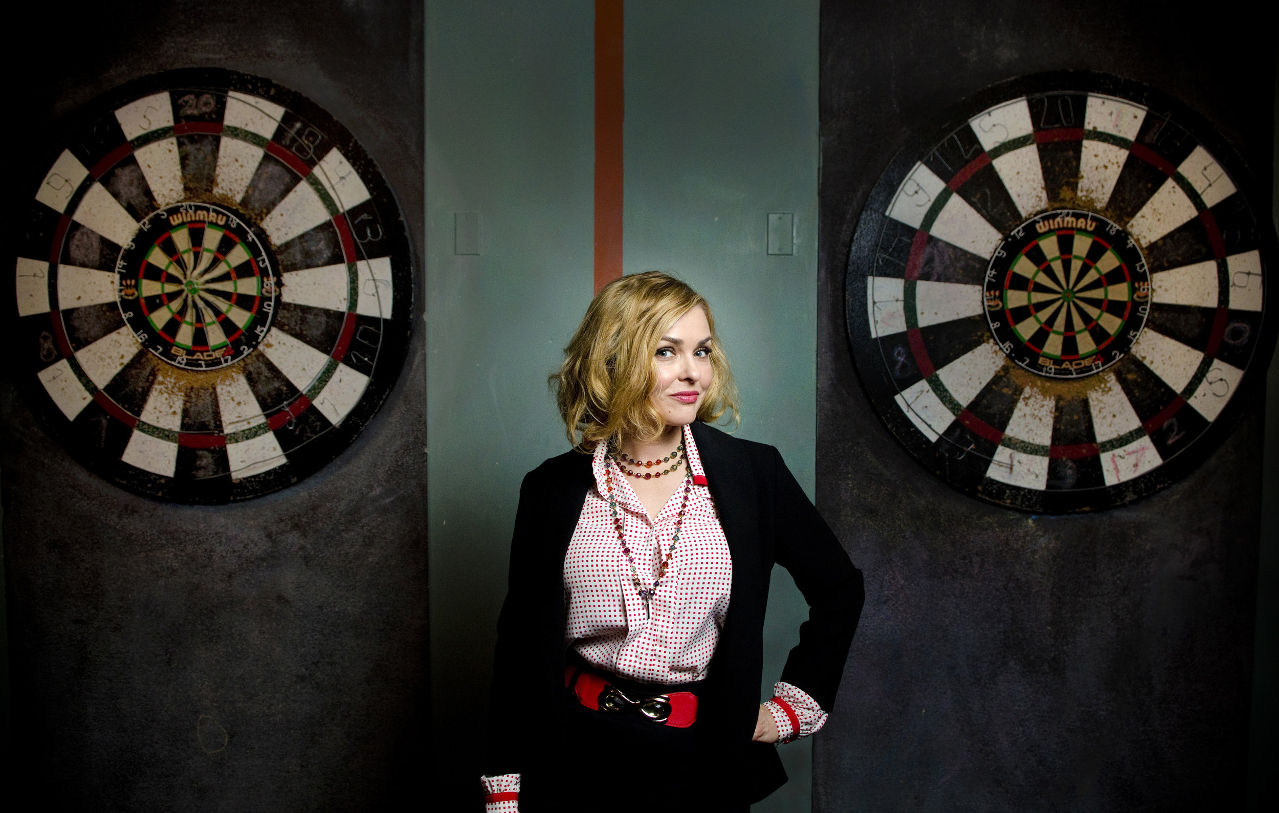 Actor and 1992 Playboy Playmate of the Year Corinna Harney of the interactive comedy show Alibi poses during a cast portrait session at Gold Spike in Las Vegas, Saturday, March 7, 2015.