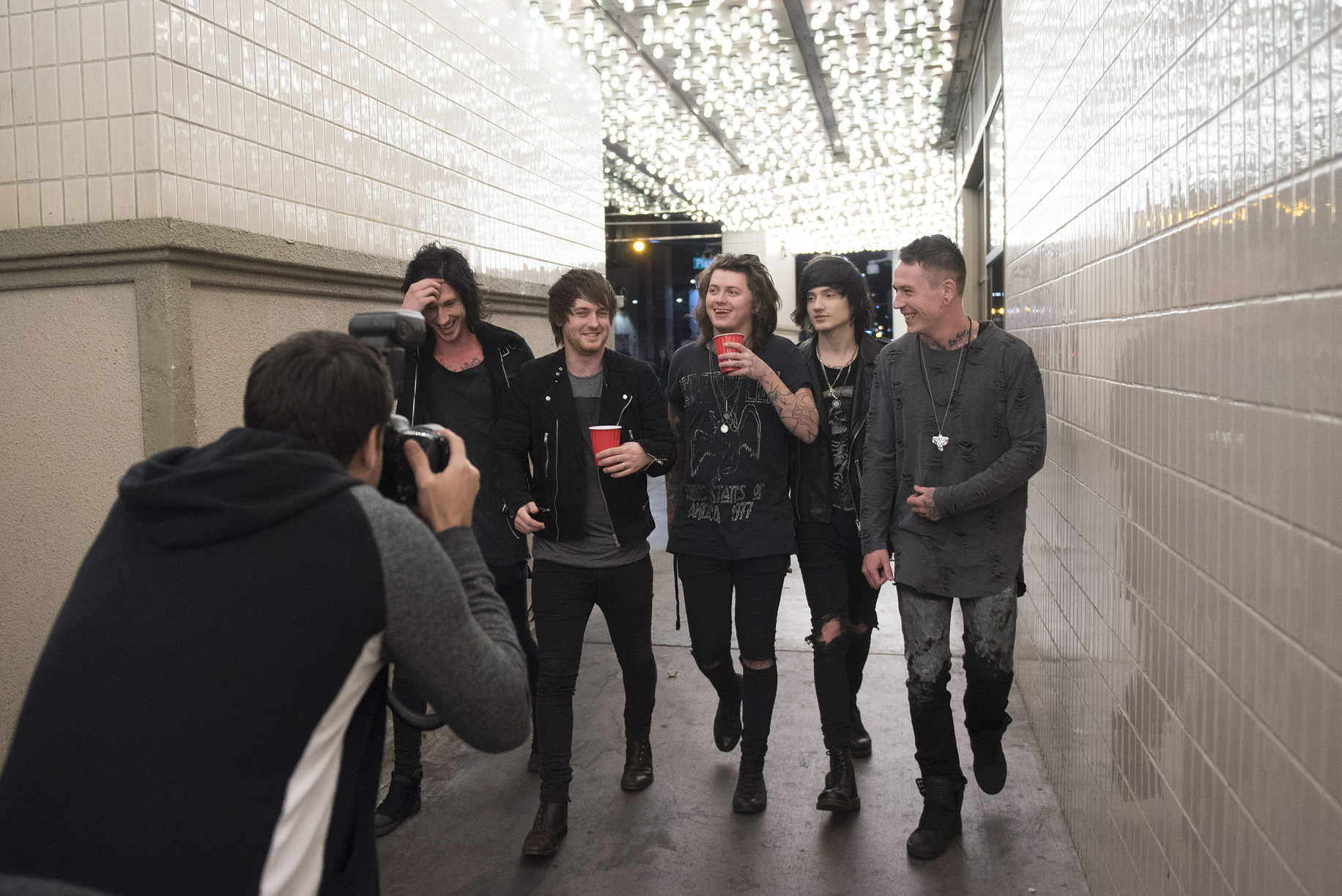 Andrew Lipovsky, left, photographs Asking Alexandria for a Kerrang! magazine photoshoot at the Plaza Hotel and Casino in Las Vegas Sunday, Feb. 7, 2016.