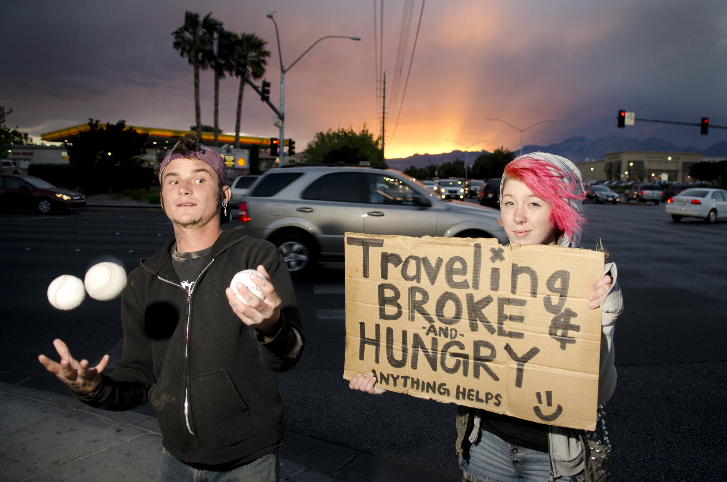 Two panhandlers pose at Fort Apache Road and Charleston Boulevard in Las Vegas, Monday, March 31, 2014.