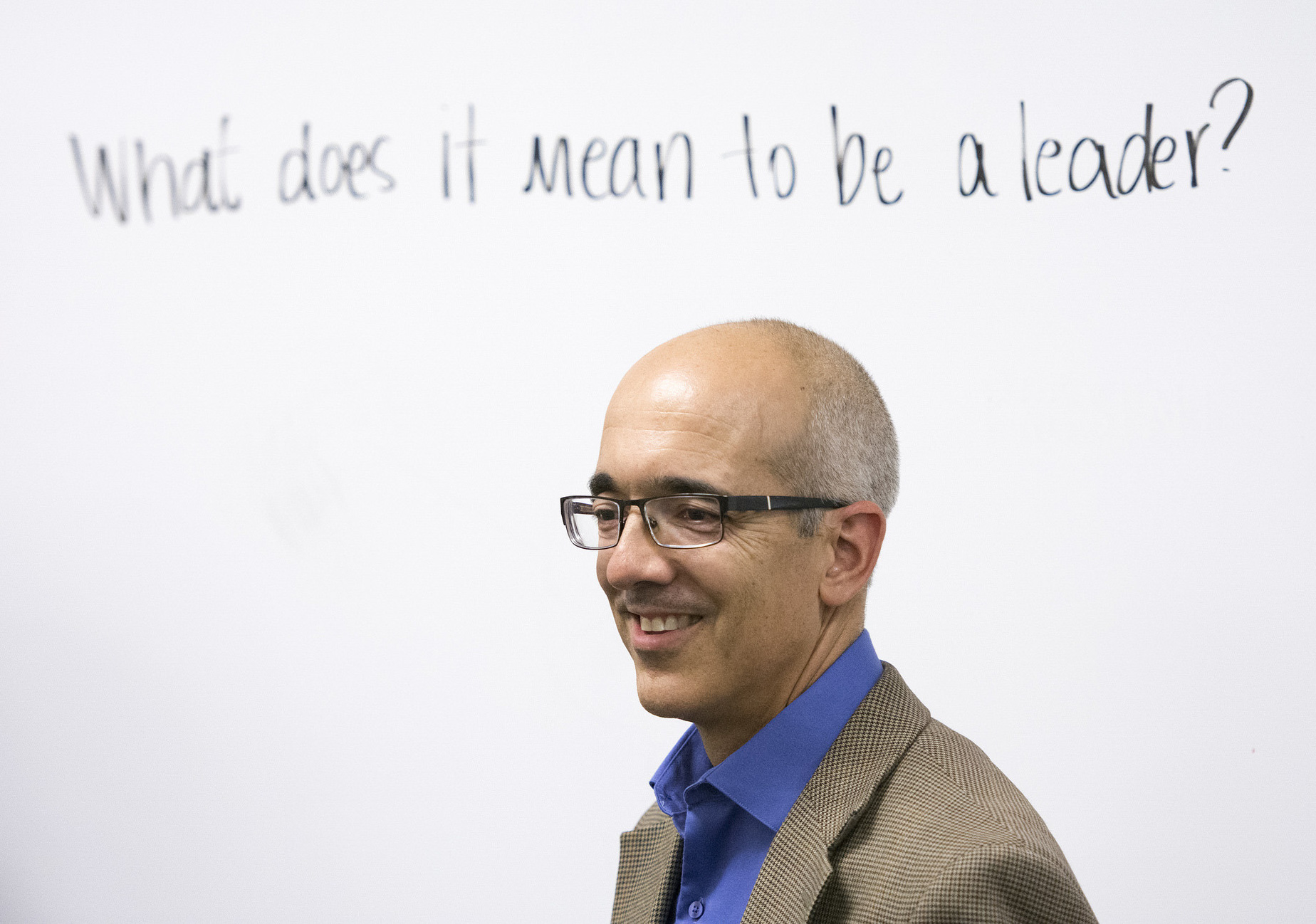 """Nevada Senator Moises """"Mo"""" Denis speaks to Global Community High School students in Las Vegas during their first day back to school following summer break, Monday, Aug. 24, 2015."""