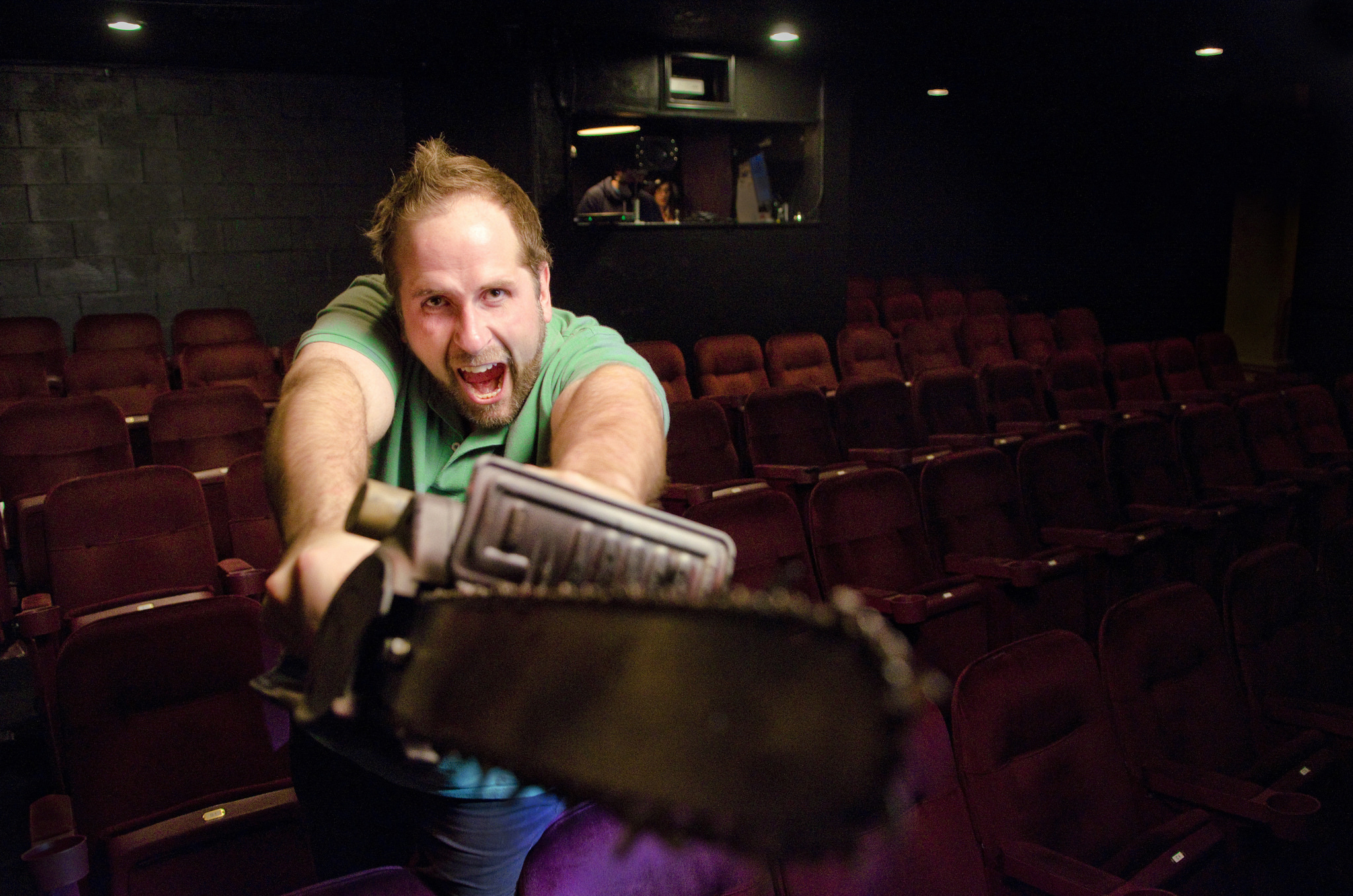 Director Troy Heard poses with a chainsaw prop at the Onyx Theatre in Las Vegas, Saturday, Jan. 31, 2015.