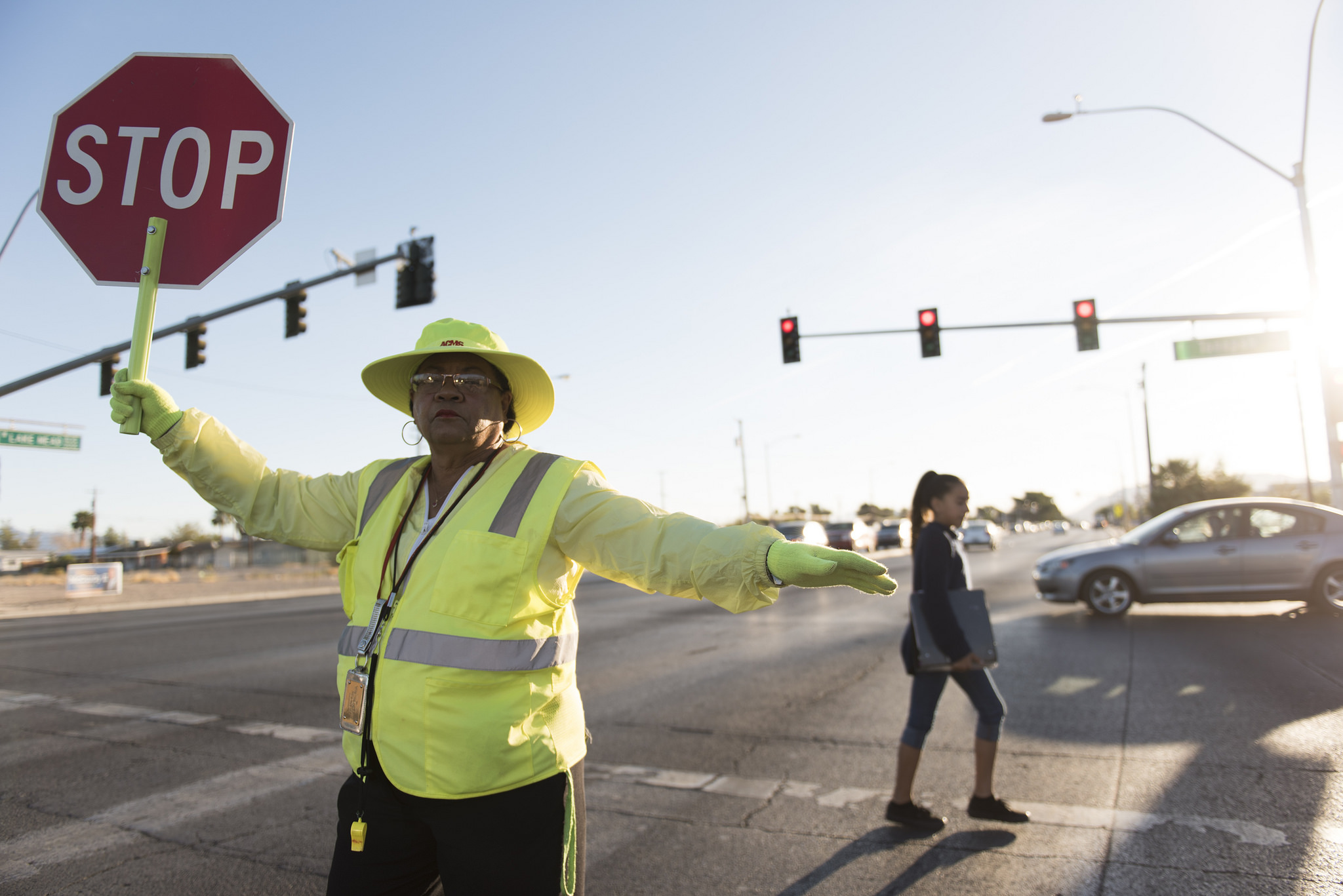 Crossing guard Patricia Bass assists a child in crossing Lake Mead Boulevard at Tonopah Drive before classes at West Preparatory Academy in Las Vegas, Thursday, Oct. 6, 2016. Jason Ogulnik/Las Vegas Review-Journal