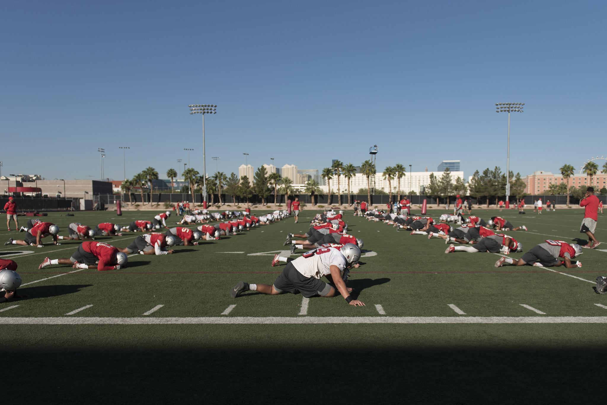 Players stretch during football practice at UNLV's Rebel Park in Las Vegas, Tuesday, Sept. 27, 2016. Jason Ogulnik/Las Vegas Review-Journal
