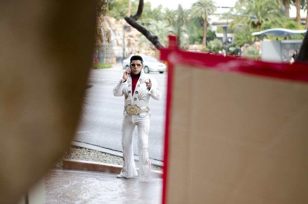 It looks like Elvis is getting some distressing news on his phone. Taken outside of Harrah's hotel-casino in Las Vegas.