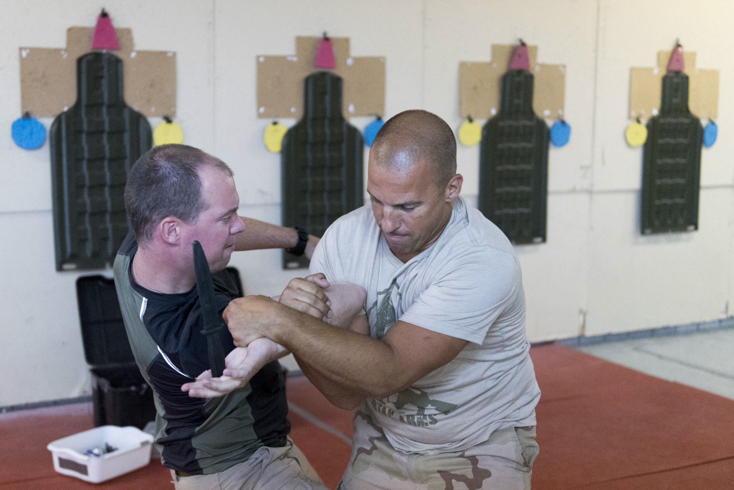 Dave Koopman, left, demonstrates combat techniques against another student at Vegas Tactical Adventures in North Las Vegas, Aug. 18, 2015