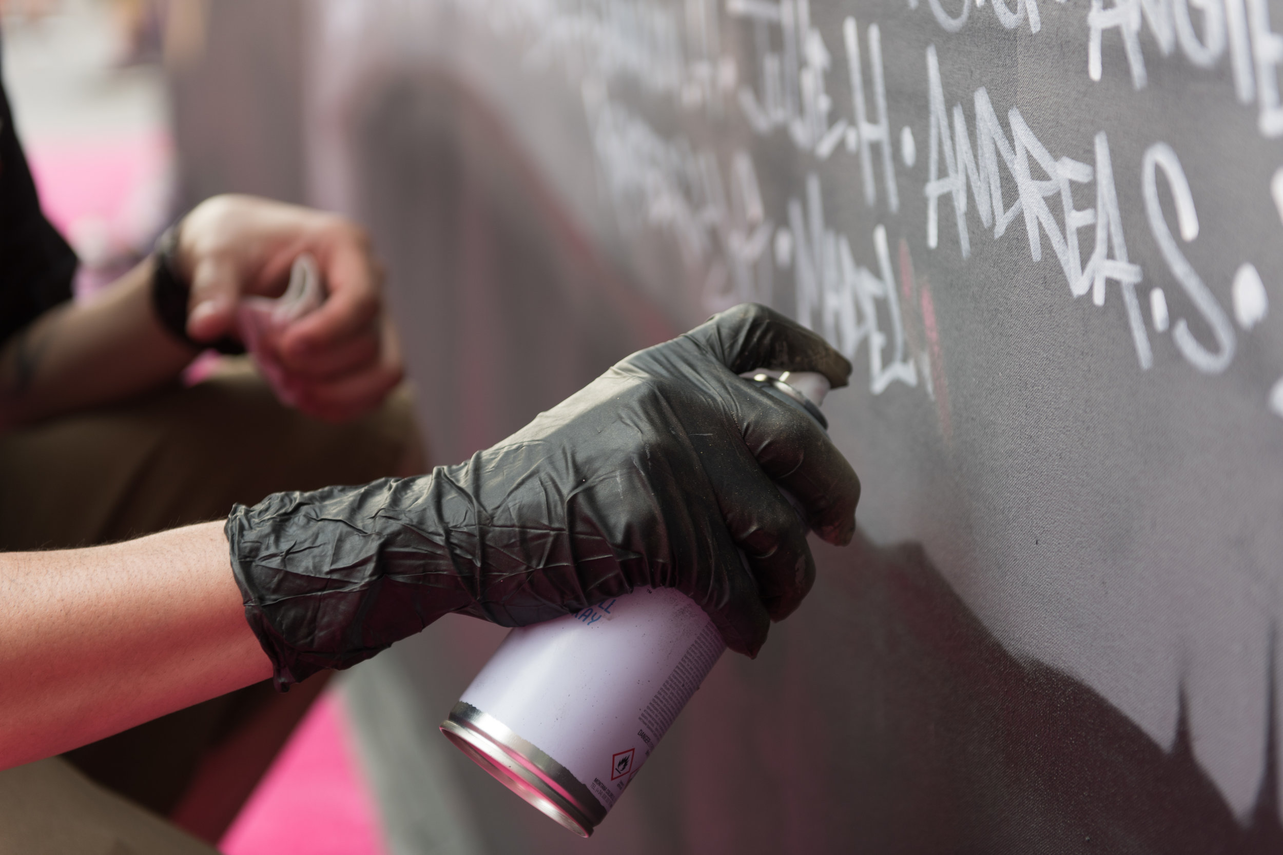 Artist Spen.1 paints a Golden Knights themed mural during a Stanley Cup game 3 watch party at T-Mobile Arena in Las Vegas, June 2, 2018. The mural features hundreds of names of fans.