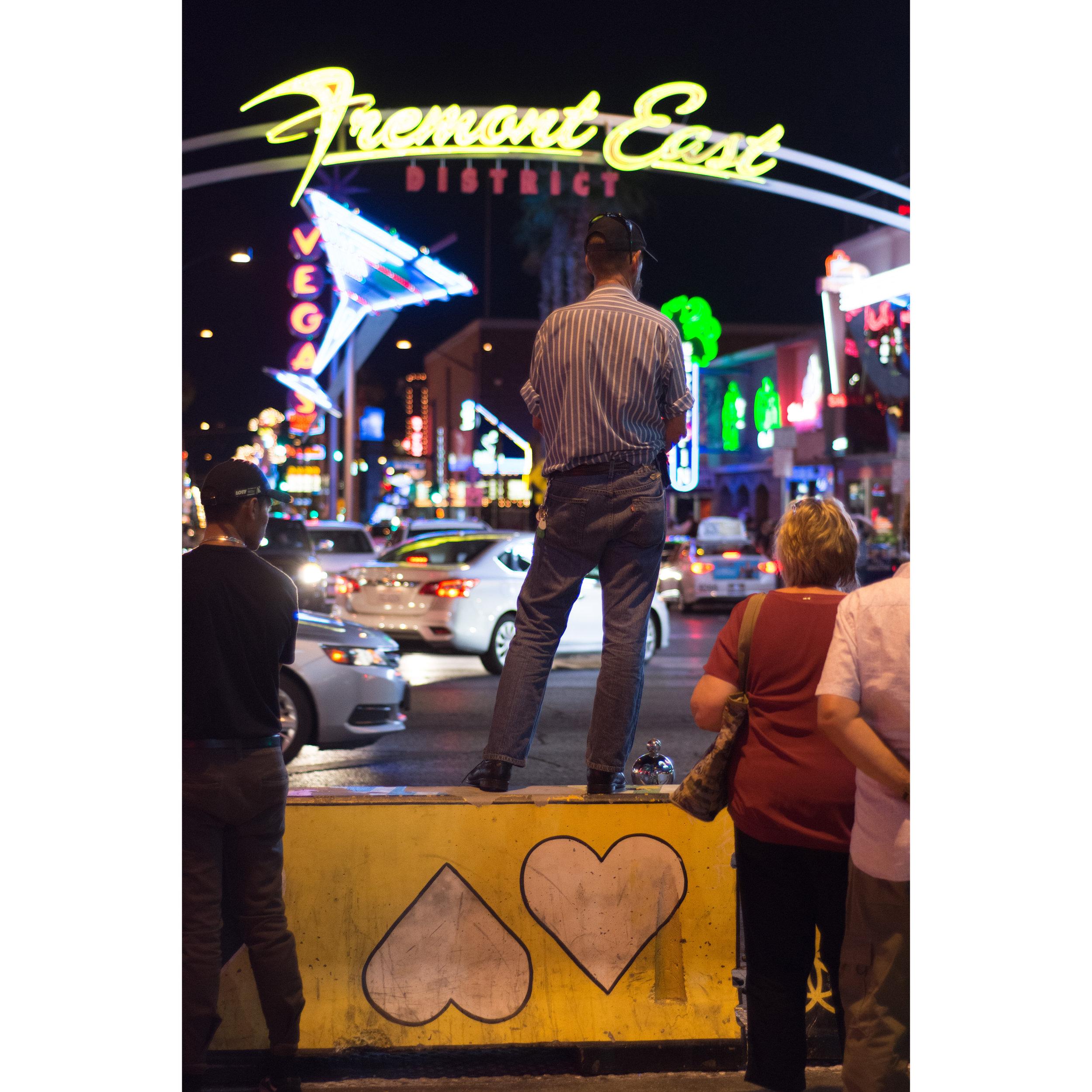 A man watches traffic on Fremont Street at Las Vegas Boulevard in downtown Las Vegas.