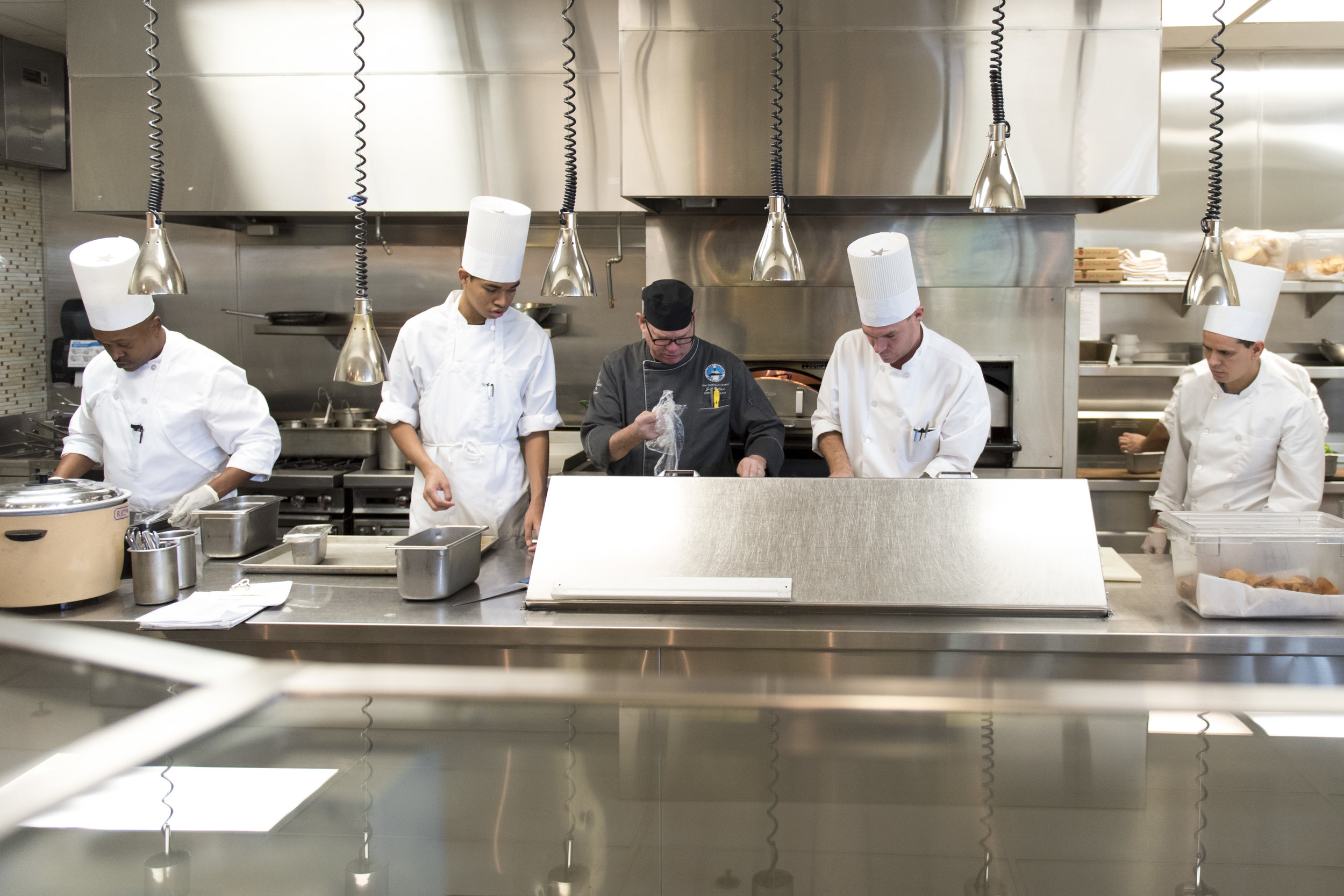 Instructor Jeff Wallace, center, teaches students during the Professional Cook class at the Culinary Academy of Las Vegas.