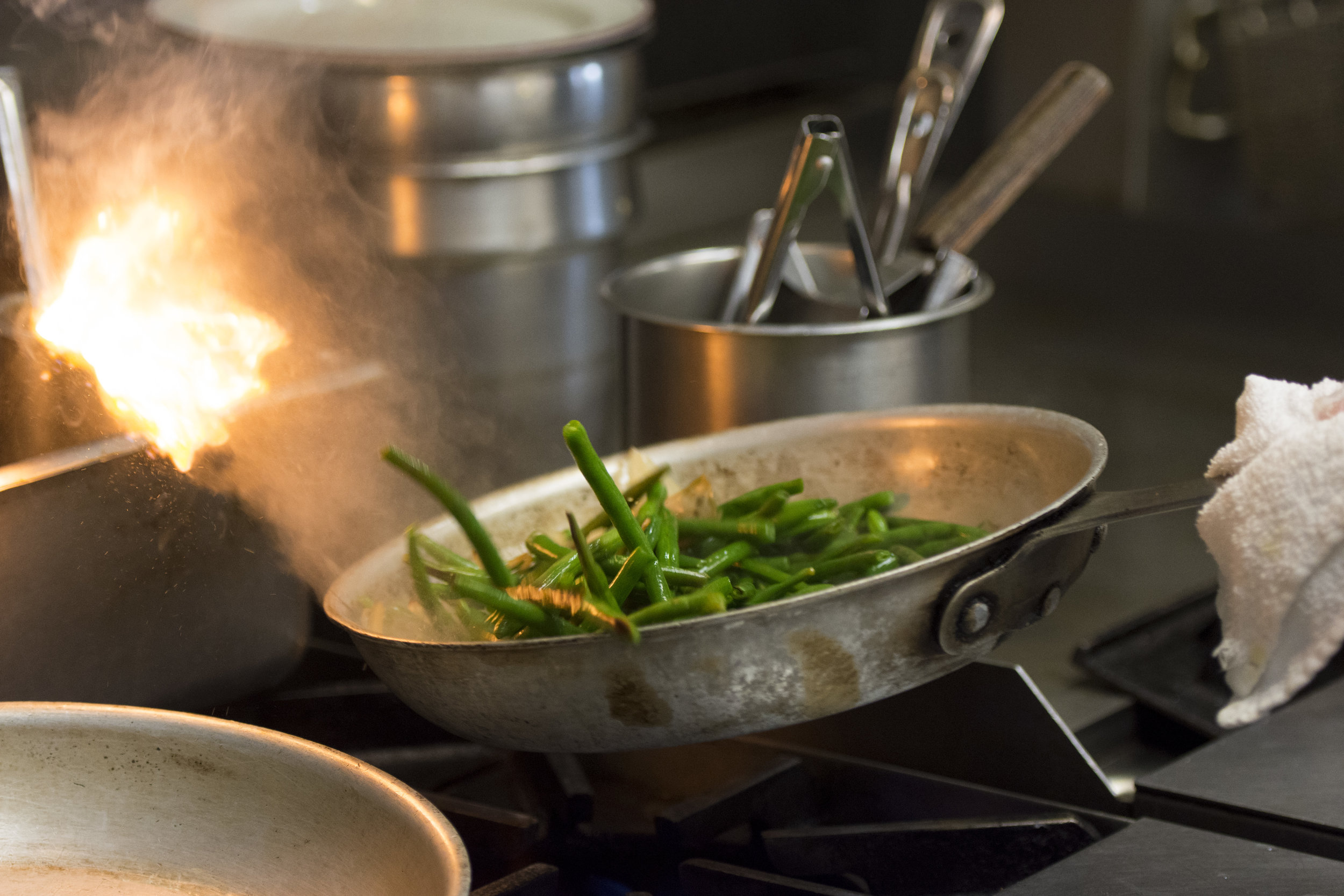 A student sautees green beans during the Professional Cook class at the Culinary Academy of Las Vegas.
