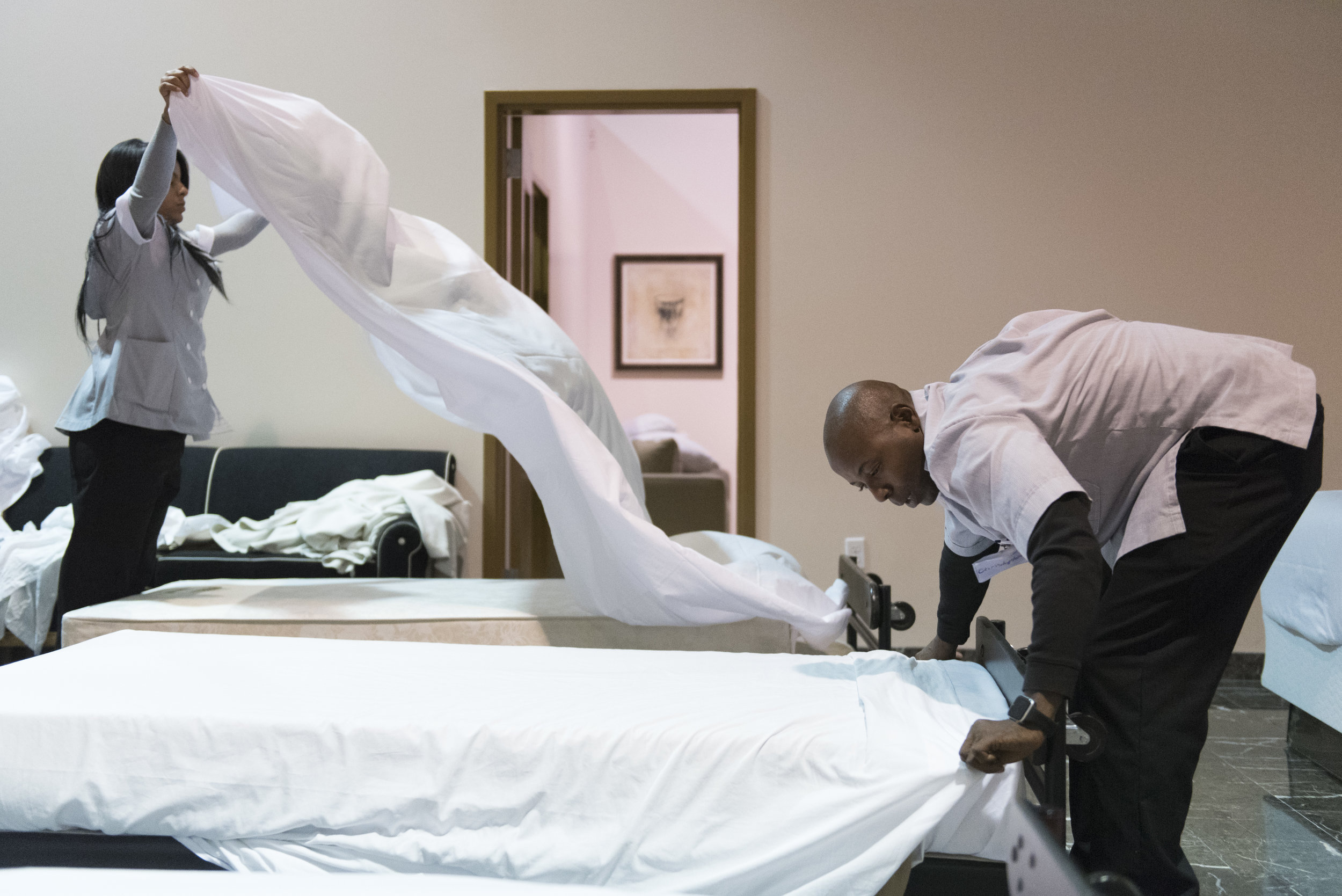 Students make beds during the Guest Room Attendant class at the Culinary Academy of Las Vegas.