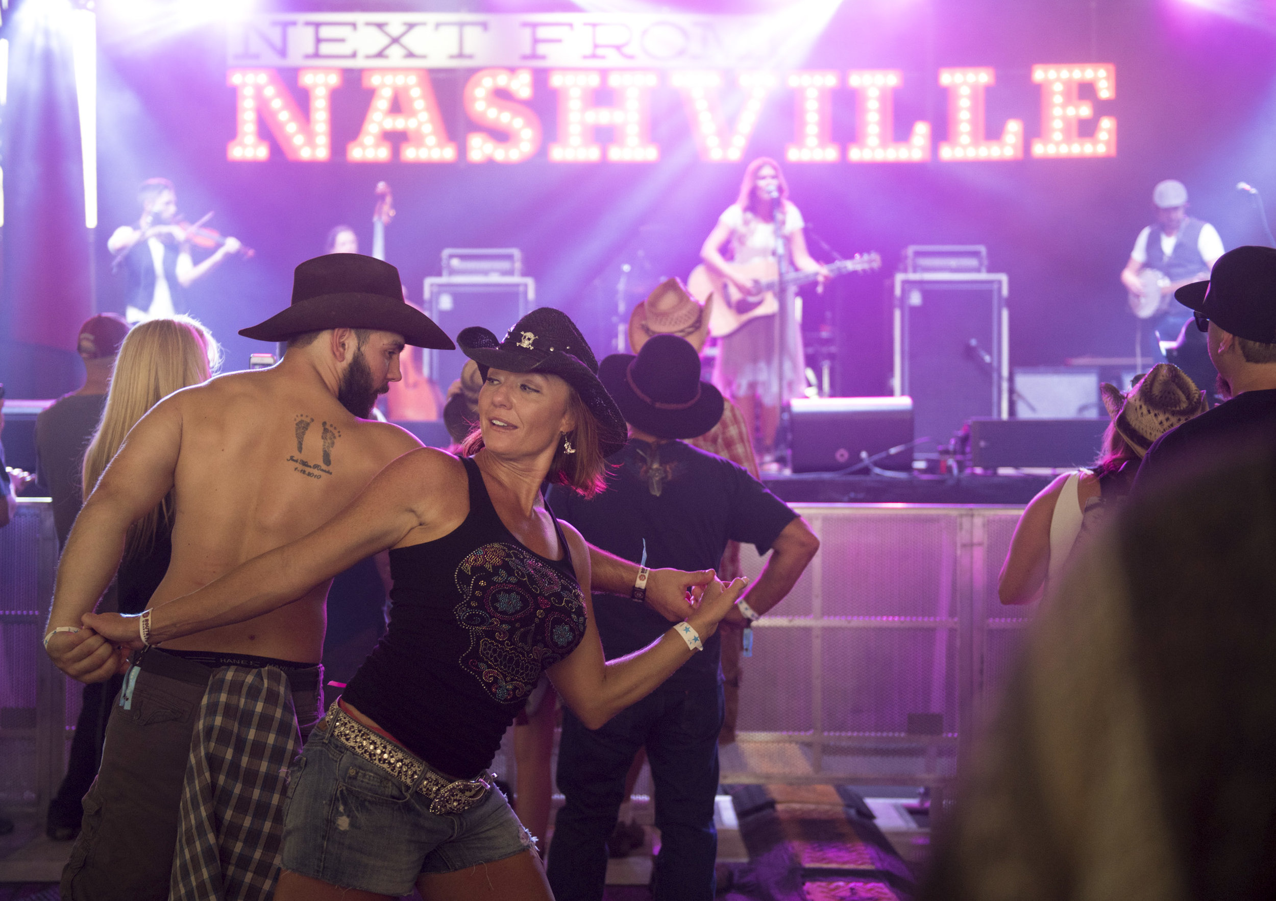 Concert goers dance at the Route 91 Harvest Country Music Festival.