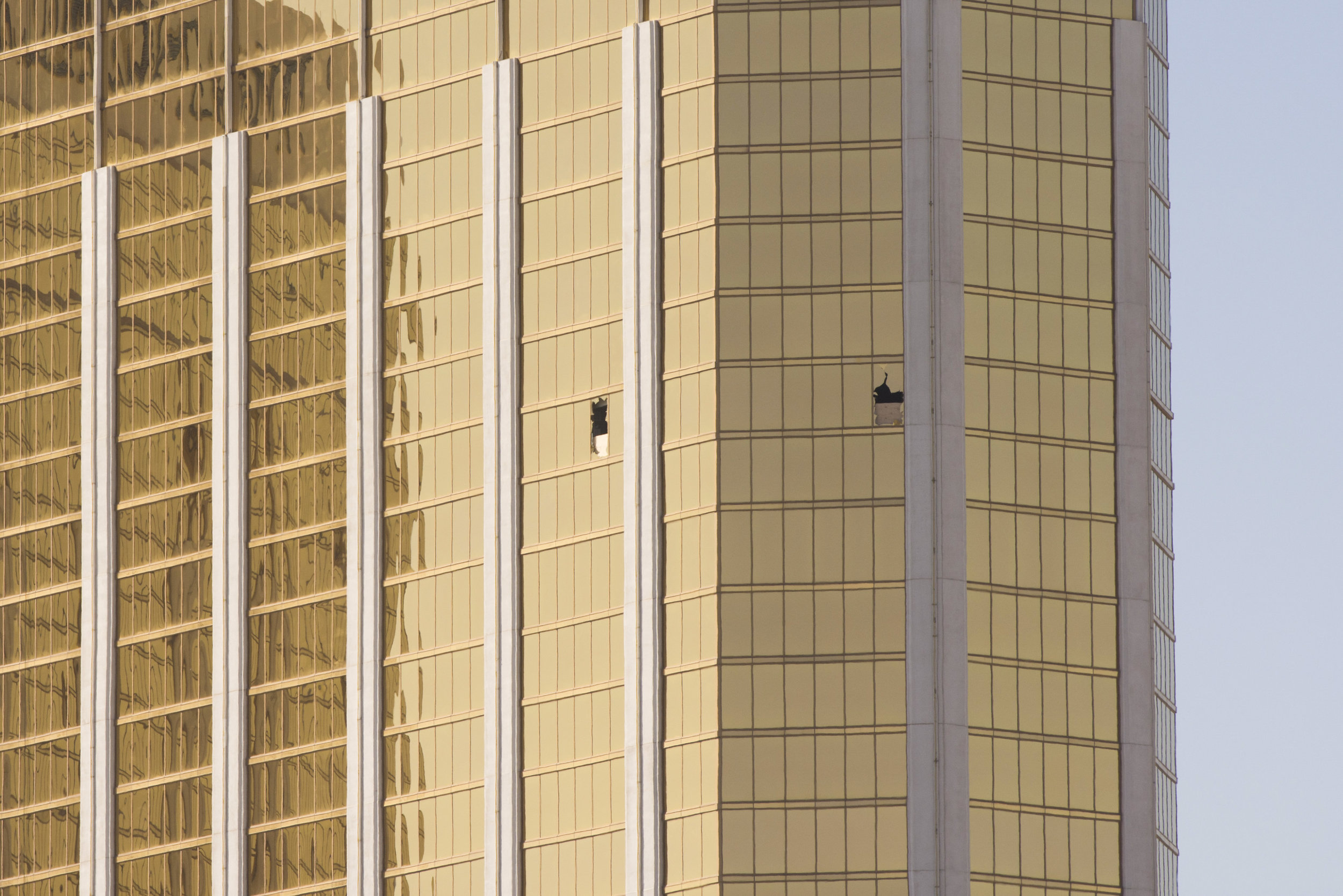 Windows are broken, showing the 32nd floor suite at Mandalay Bay hotel-casino from where Stephen Paddock shot and killed 58 concert attendees.