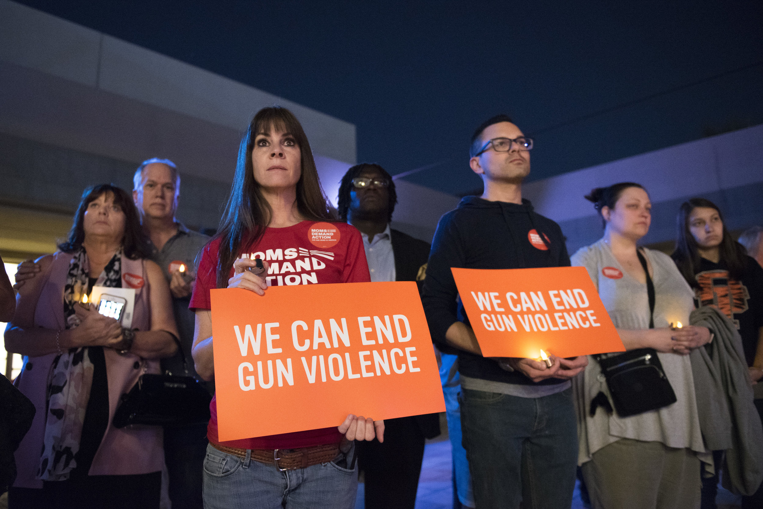 At the East Las Vegas Community Center, Lisa Bailey, third from left, and other attendees listen as Nev. Sen. Pat Spearman, D-North Las Vegas, speaks during a vigil to commemorate the victims of the Route 91 Harvest Country Music Festival mass shooting.