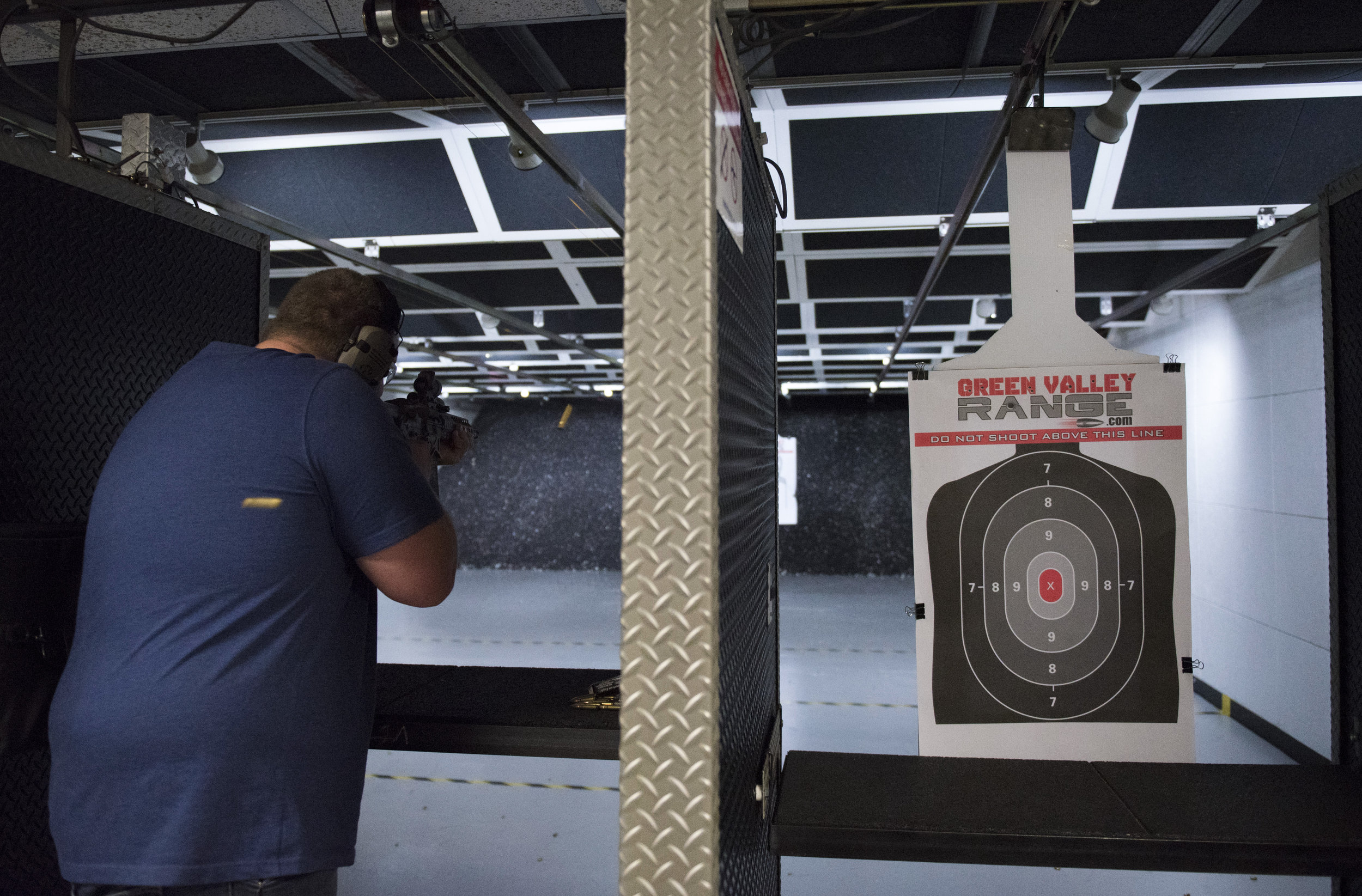 Battle Arms Development employee Tyler Schlappi does a function test on a short-barreled rifle at Green Valley Range in Henderson, Nev..