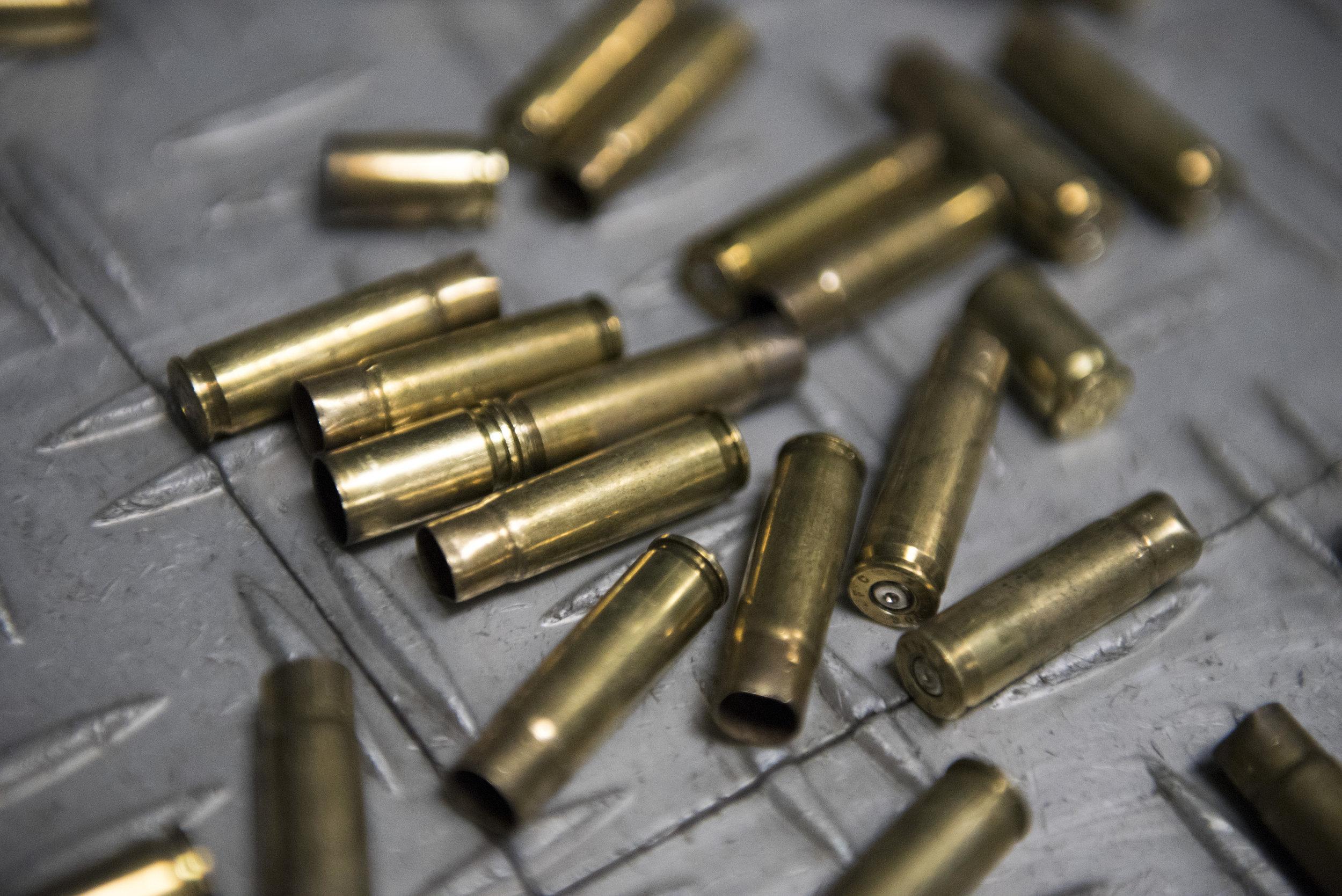 Bullet casings are scattered across the floor at Green Valley Range in Henderson, Nev..