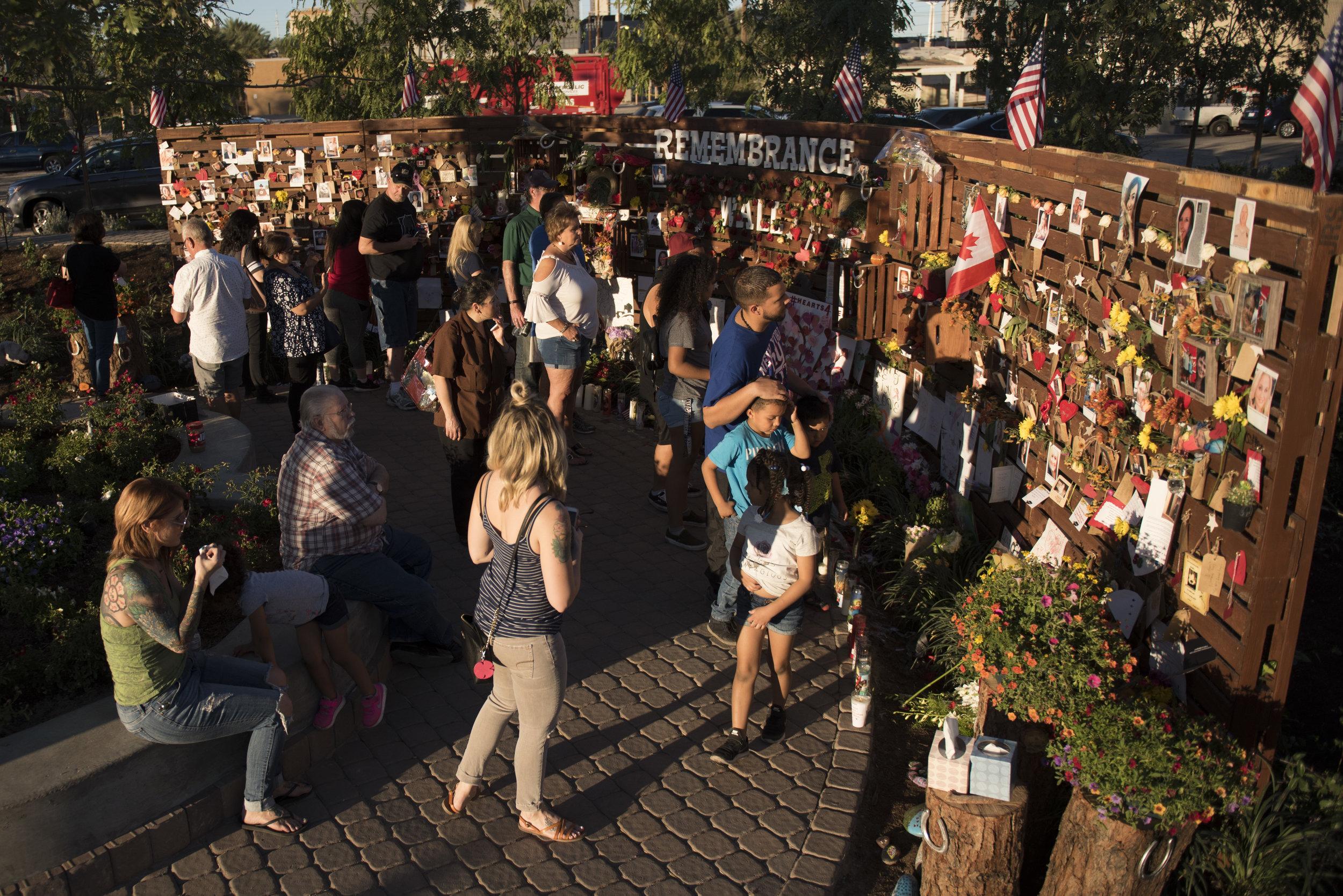Visitors walk around the newly opened Las Vegas Community Healing Garden.