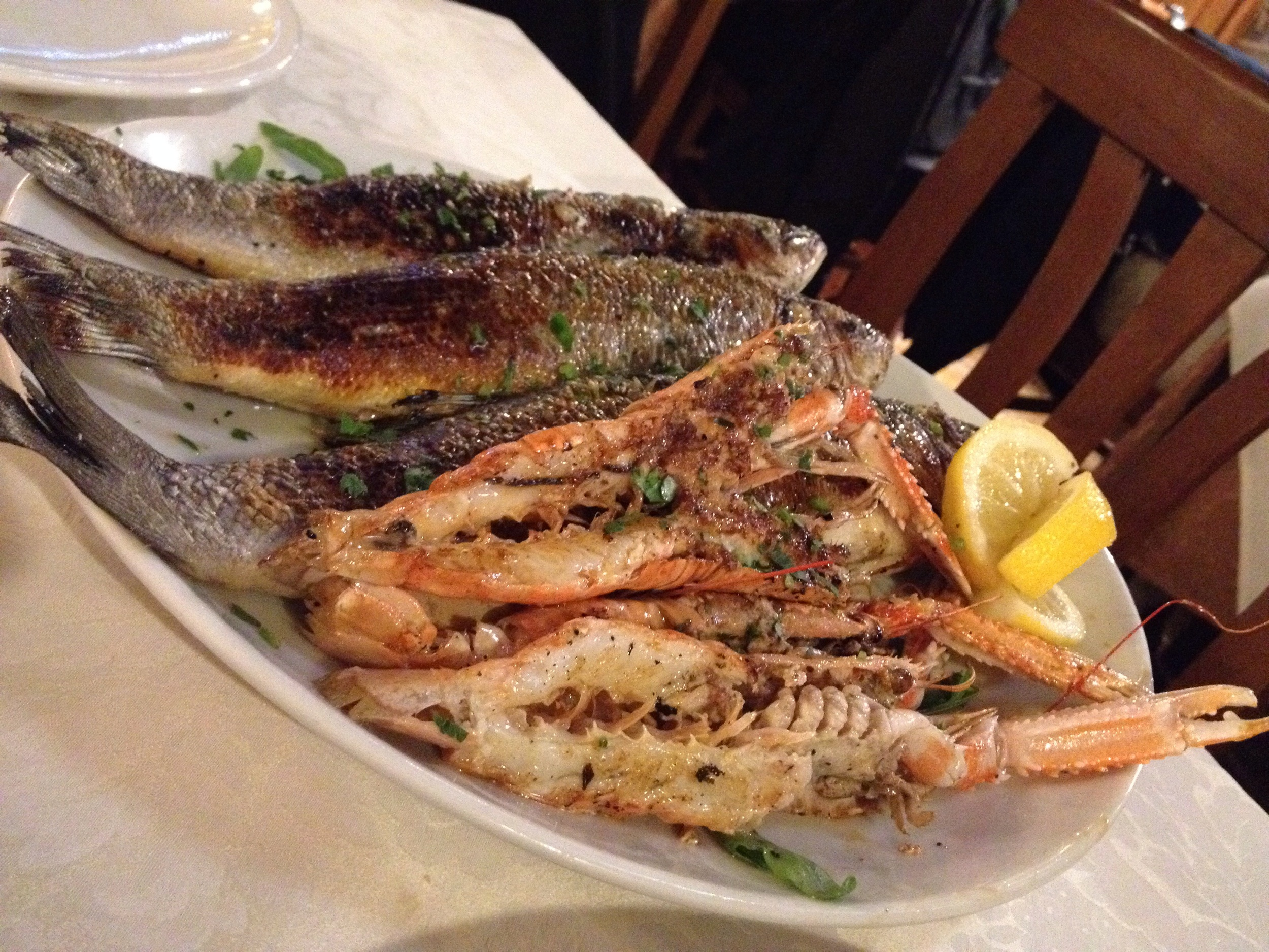 Grilled fish of some sort and scampi