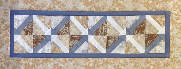 All Ways Arrows Table Runner is made in the paper piecing style of quilting.