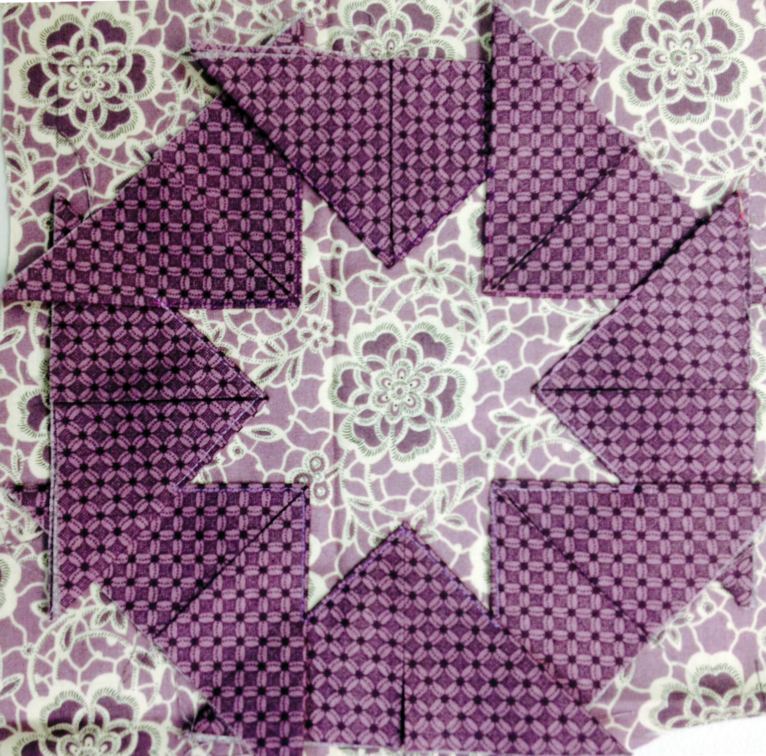 Sew around the sides of the prairie points to create a star hot pad.