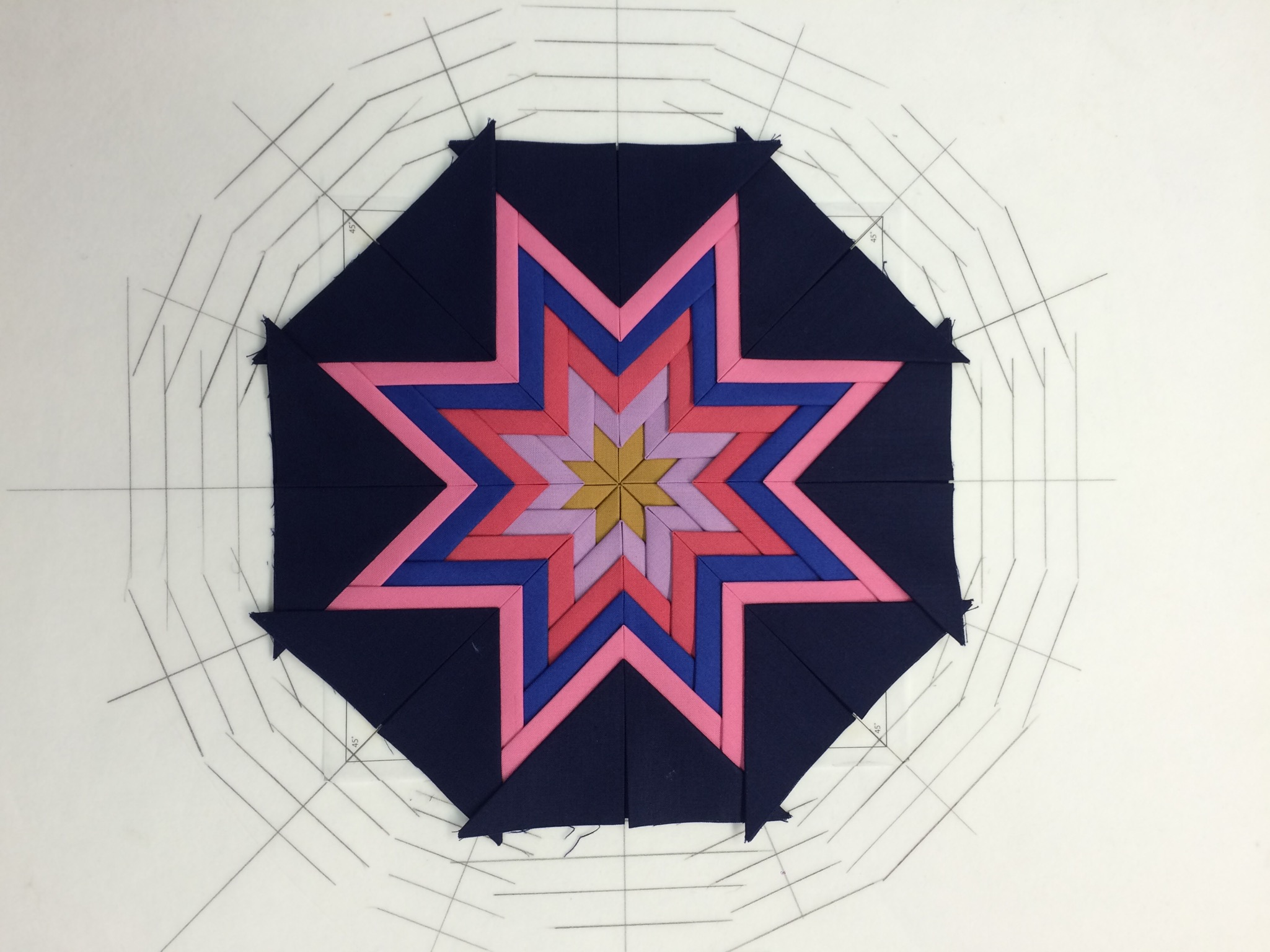 This is an 8 point star with prairie points every 45 degrees.