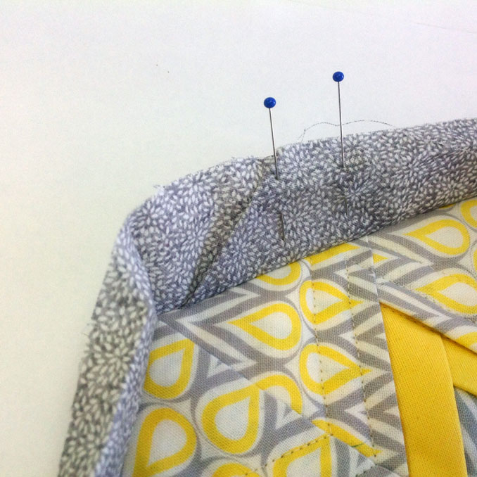 Next, you will need to hand sew the closure where the two ends meet. .I like to fold over the binding and pin these together and sew with a very small applique stitch.