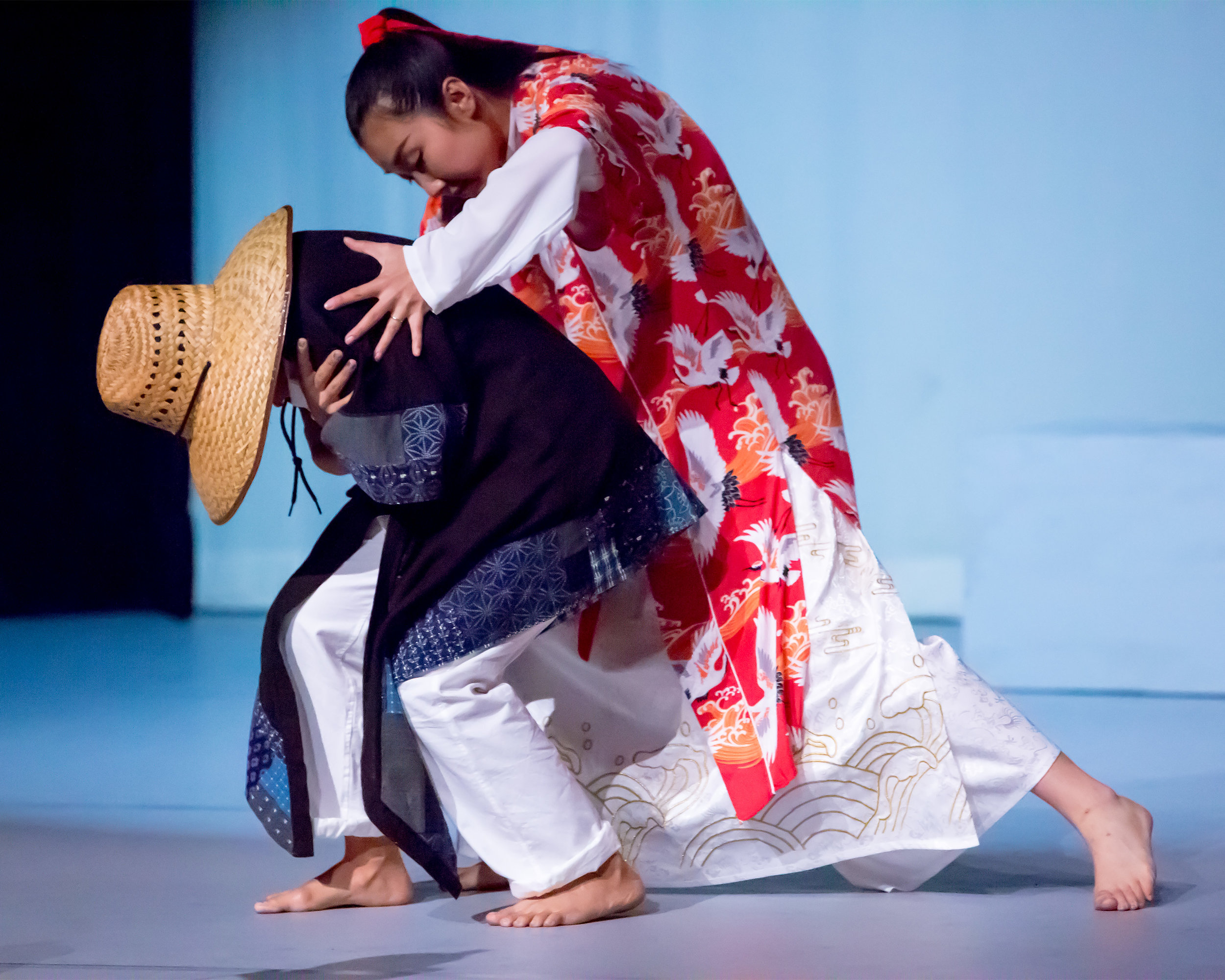 The Lord of the Cranes (choreographed and danced by Jingqiu Guan) takes pity on a shivering pauper (Kristianne Salcines)