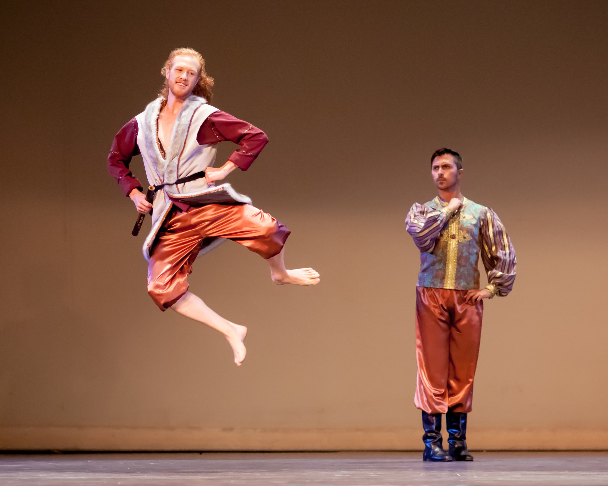 "Andrew Leathers (leaping) and Edgar Lepe as the king in ""The Happy Man's Shirt,"" choreographed by Sherene Melania, San Francisco"