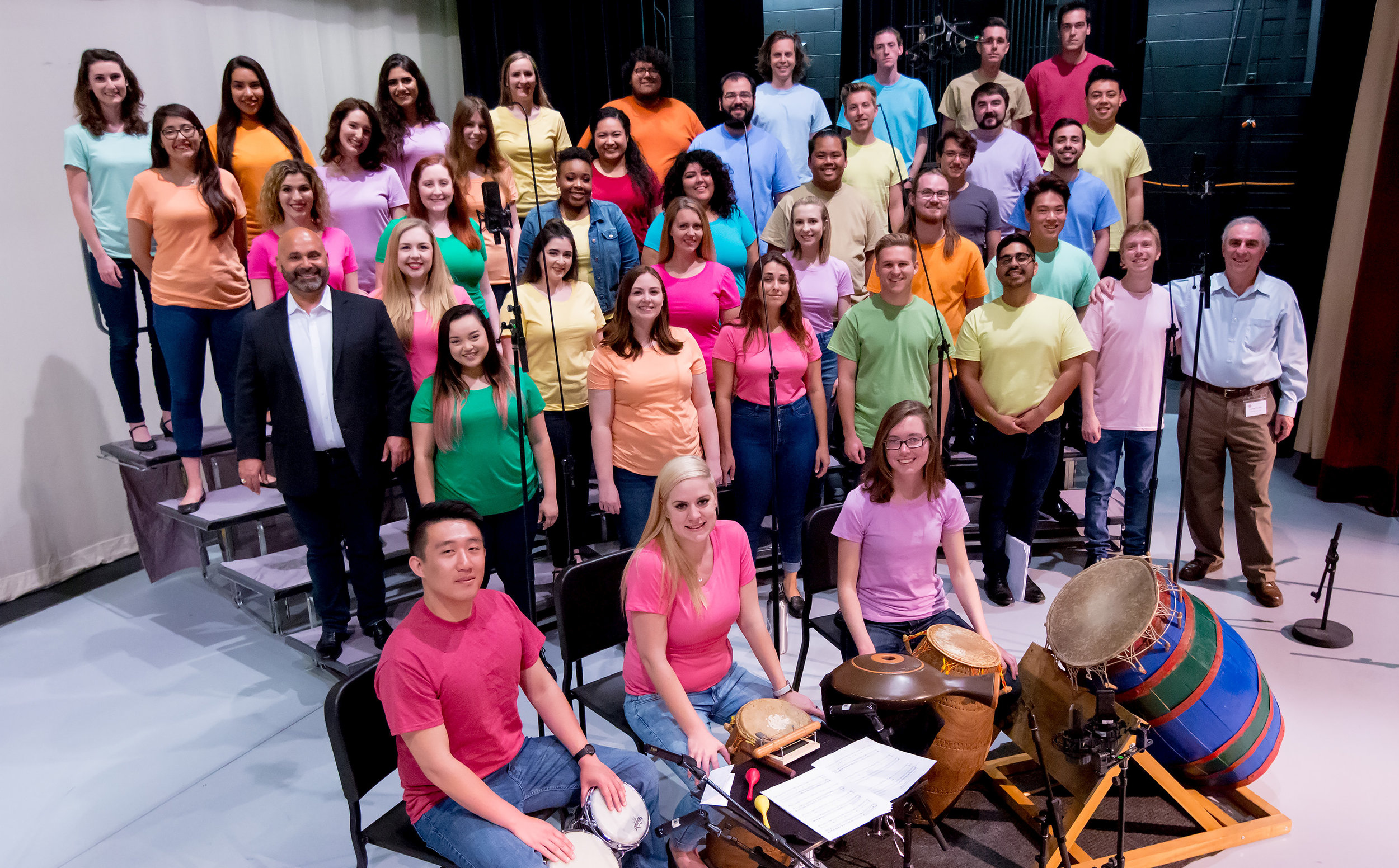 The Bob Cole Chamber Choir of CSU Long Beach on day of filming, conducted by Jonathan Talberg (2nd row, left), accompanied by percussionists Arthur Lin, Petra Elek and Bailey O'Donnell on African instruments