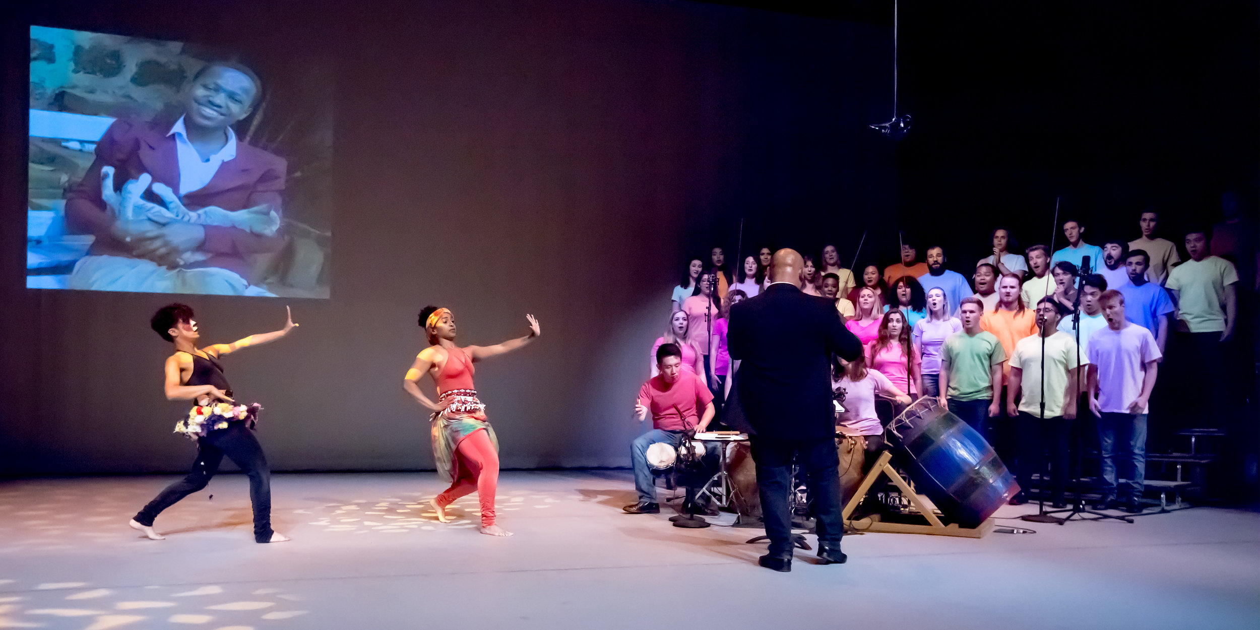 "Anindo Marshall choreographed ""The Cat's Protector,"" based on a folk tale from Tanzania. Seen above, Nateli Ruiz and Shannon Grayson dance on stage with the choir."