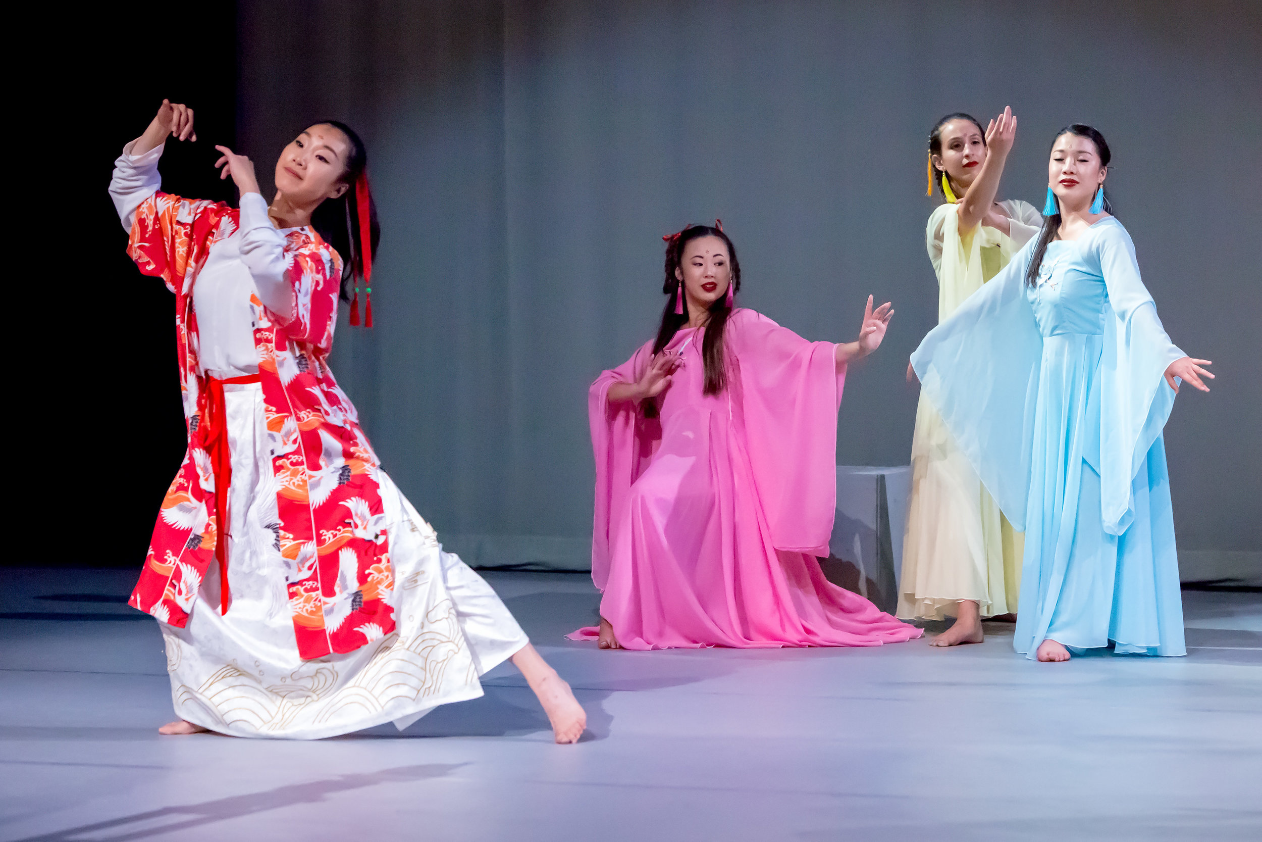 "(L to R) Jingqui Guan (choreographer) plays celestial flute, Kyra Sakamoto, Kelsey Manes, and Mizuki Sako as Cranes in ""Lord of the Cranes"""