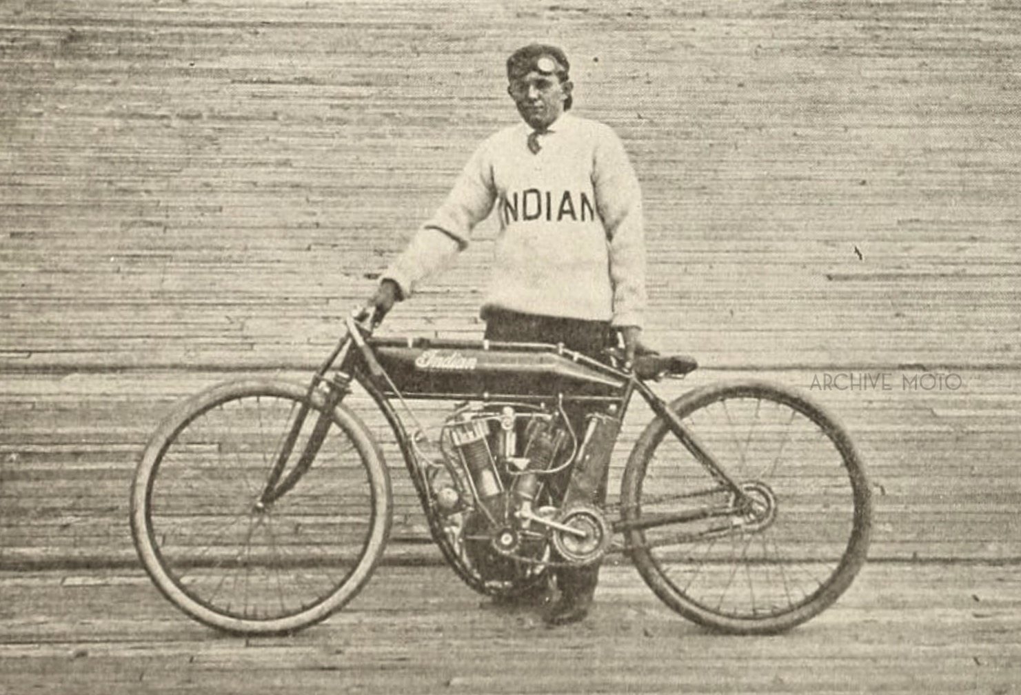 """Nineteen year old W.E. Hasha, aka Eddie, aka, """"The Texas Cyclone"""" inside the Springfield Stadium Motordrome earlier in 1911 before he traveled south to race in Birmingham against Stubbs, Mitchell, Balke, and DeRosier later fall. The machine he is standing with is the one that he most likely competed on for the events at the Alabama State Fairgrounds as he acquired his monstrous and elegant 8-Valve shortly after that event, just before the start of the 1912 season in Los Angeles."""