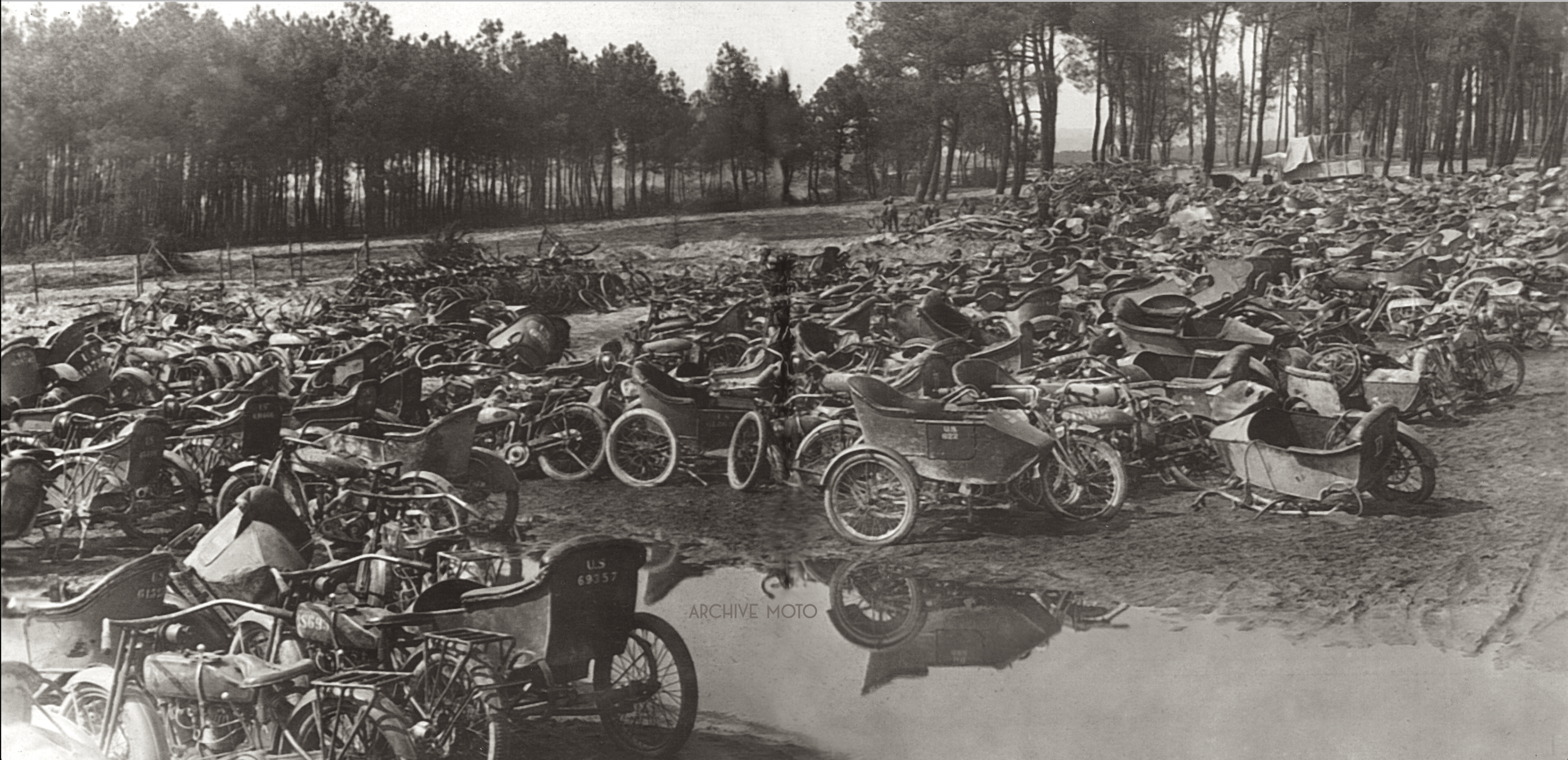 After the Treaty of Versailles was signed on June 28, 1919, the tens-of-thousands of American motorcycles, which had flooded onto the battlefields of Belgium, Germany, and France during WWI were collected for scrap or private sale. Countless mechanical boneyards like this one managed by the US Army Corps of Engineers in Le Mans, France were established to deal with countless damaged and surplus machines. Though it no comparison, the scene of so many abandoned and disabled machines heaped in a muddy French field resonates the mass destruction of such a terrible affair, a war that truly changed the world.