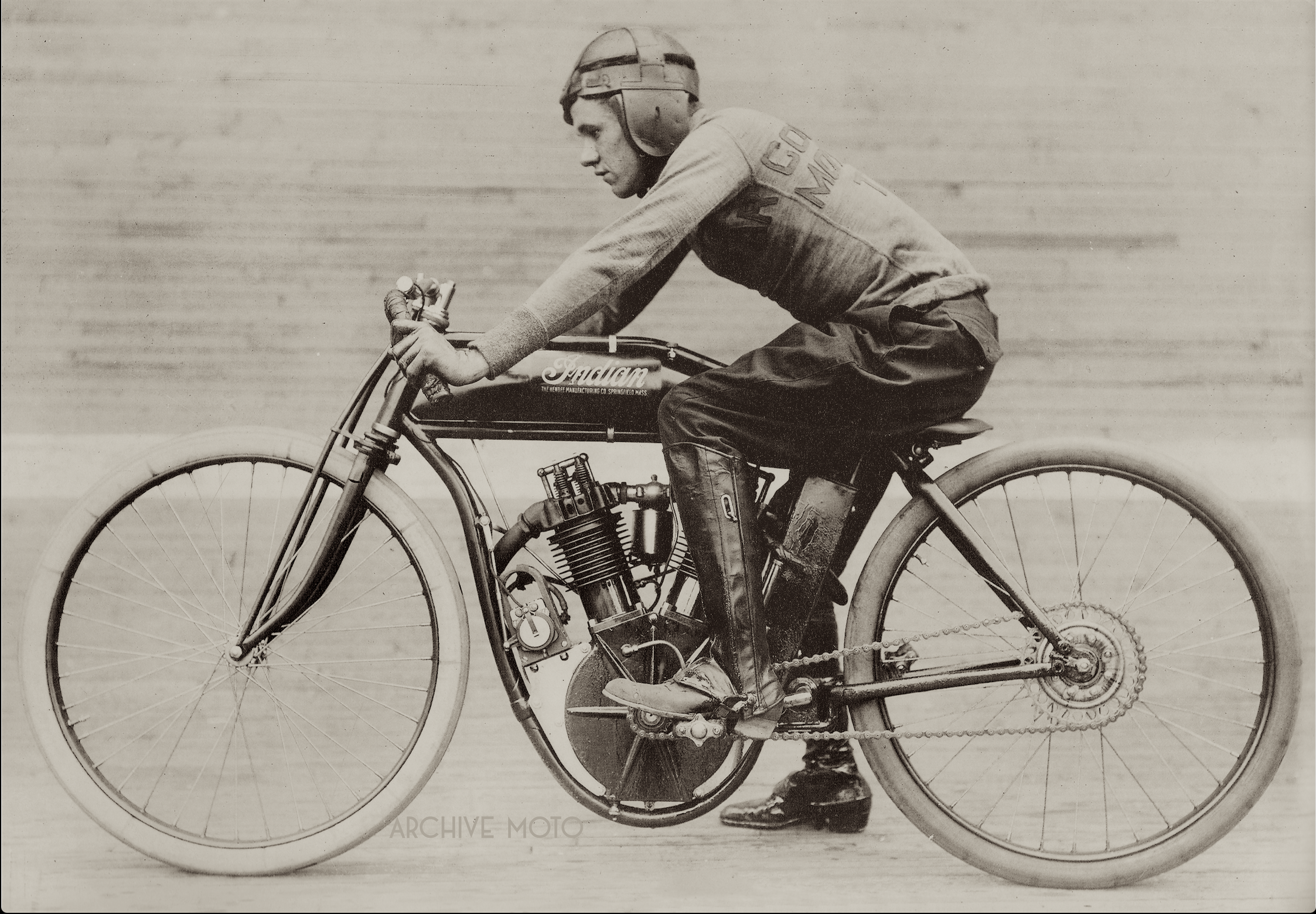 Seen in this photo is the 20 year old Texas Cyclone, star of professional board track racing in 1912, Eddie Hasha onboard his No. 32 factory Big Base 8-Valve in front of the 48 degree track at Columbus, OH, just before his death in the early Fall of 1912.