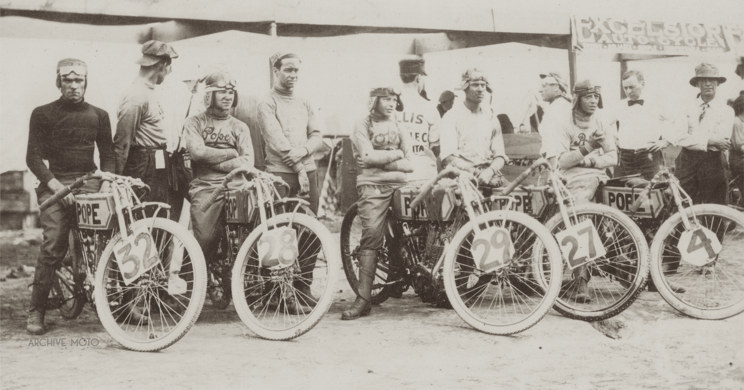 Seen in this image are the five members of the Pope factory racing team at the inaugural Dodge City 300 on July 4, 1914. They are, in no specific order, Wichita's Edgar Roy, Westfield's William Lambert, E. Fabian and Maurice Tice from Bakersfield, and Dodge City's own H. Crutchley.
