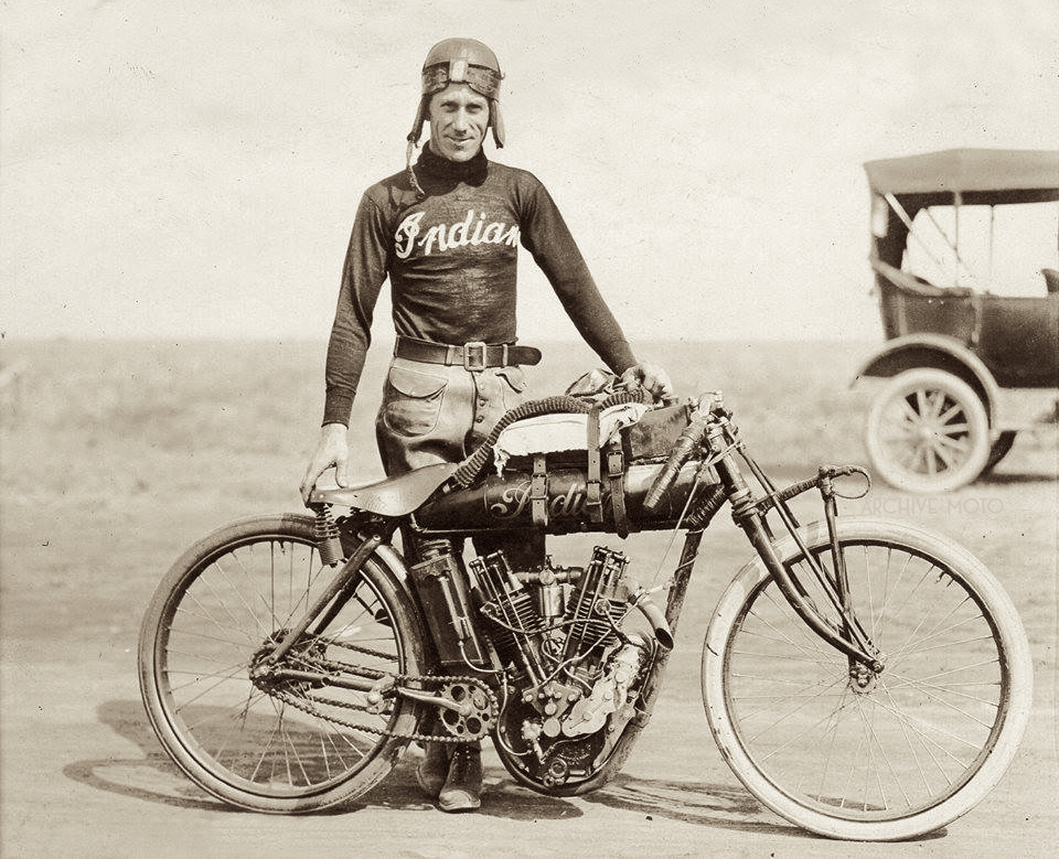 "Photographed here at the annual Dodge City 300 in 1916, Erle ""Red"" Armstrong poses with his Indian factory 8-Valve special, though due to mechanical issues Red was forced to drop out of the race around the 70th lap."