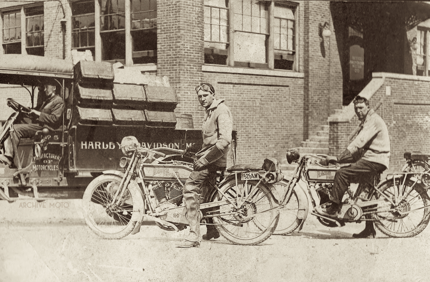 Jack Bernvitzke and Dan Klapproth onboard their Harley-Davidson 10F's in front of the Milwaukee factory just before their transcontinental adventure in the late summer of 1914.