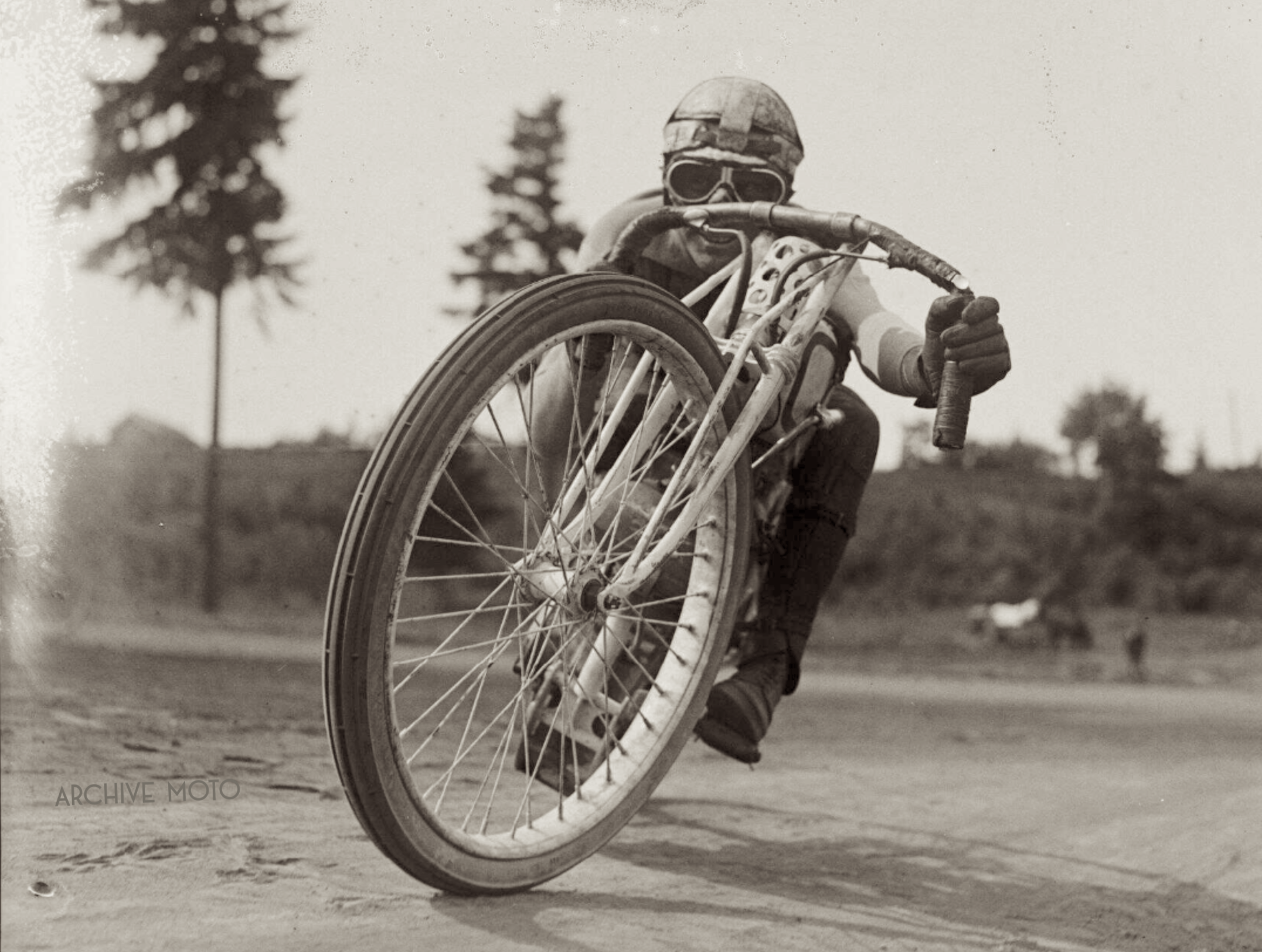 Harley-Davidson Wrecking Crew member Fred Ludlow posing onboard his teammate Otto Walker's white Banjo 2-Cam 8-Valve factory special at Portland's Rose City Speedway in May, 1921.