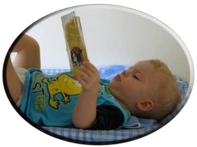 0-3-Baby-reading-Book.png