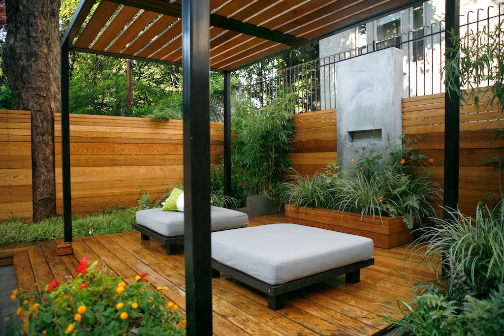 A key request of the clients was for us to include a private space within the backyard where they could relax together. Our pergola design with a cement accent wall to break up the monotony does the trick.