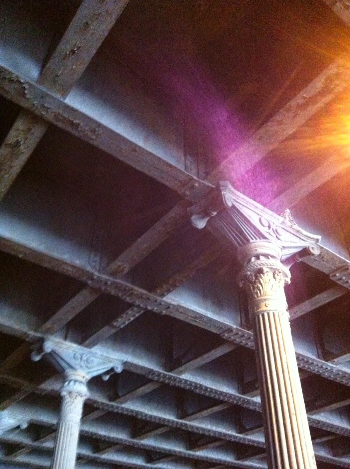 Corinthian-esque columns supporting the coffered ceiling of this tunnel.