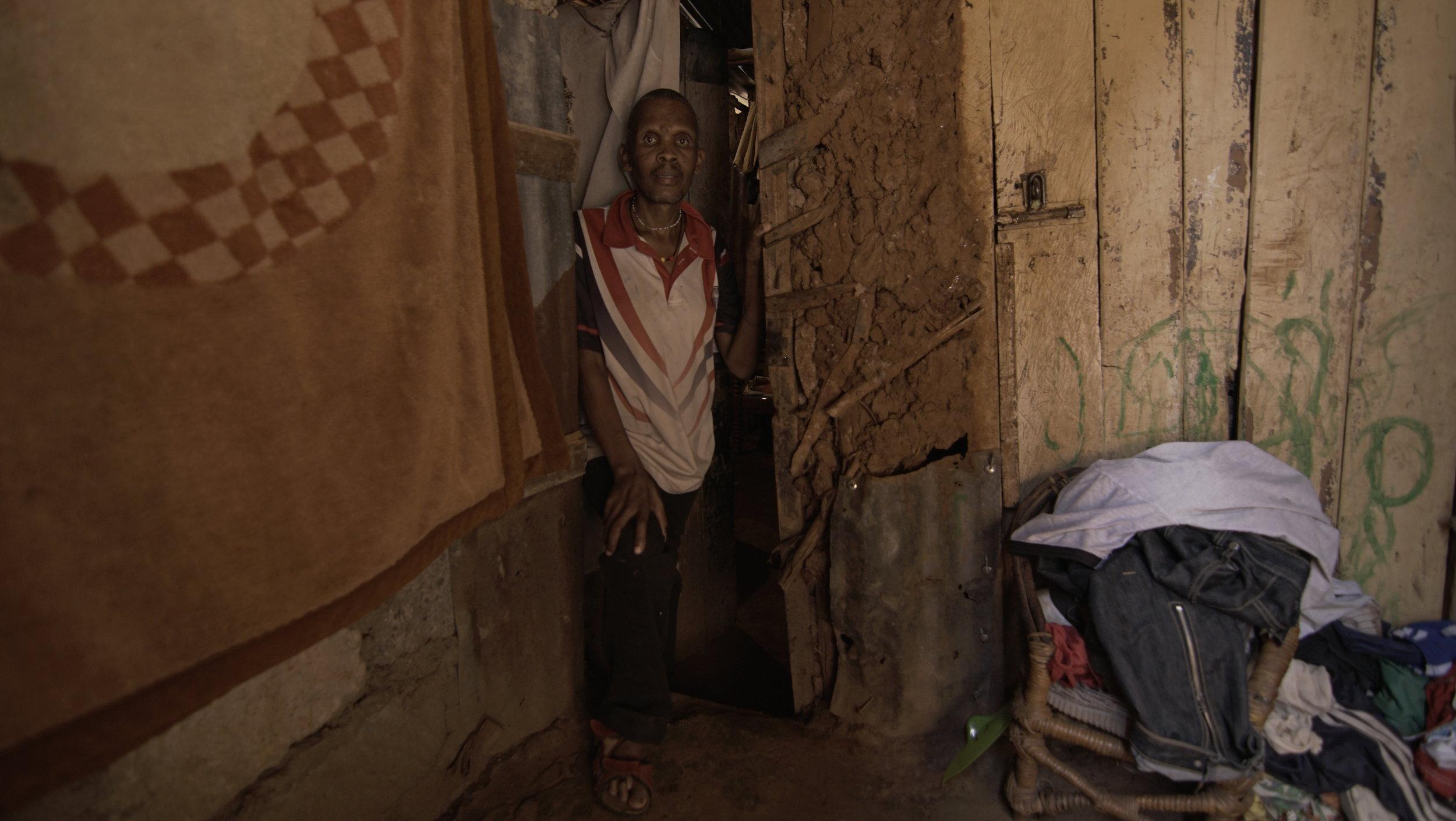 Simon at his home in Kibera