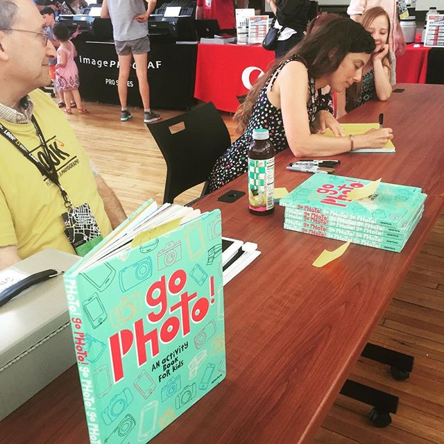 "Happening now at Family Photo Day: ""Go Photo!"" Activity Book for kids signing! Come get your photo taken, make crafts and get your books signed by Abigael Ellerglick and Harper Tidwell, two #Charlottesville teens featured in the book! #aperture #look3festival #family @cvillejeffschool"