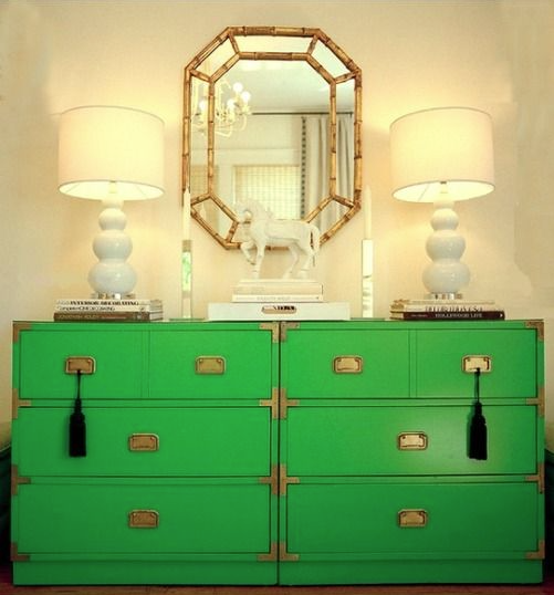 Beautiful green chests anchoring two, modern white lamps. Loving the accessories and simplicity of this room.