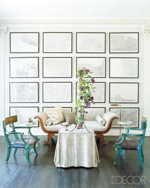 I love the idea of creating a floor to ceiling gallery wall of artwork.